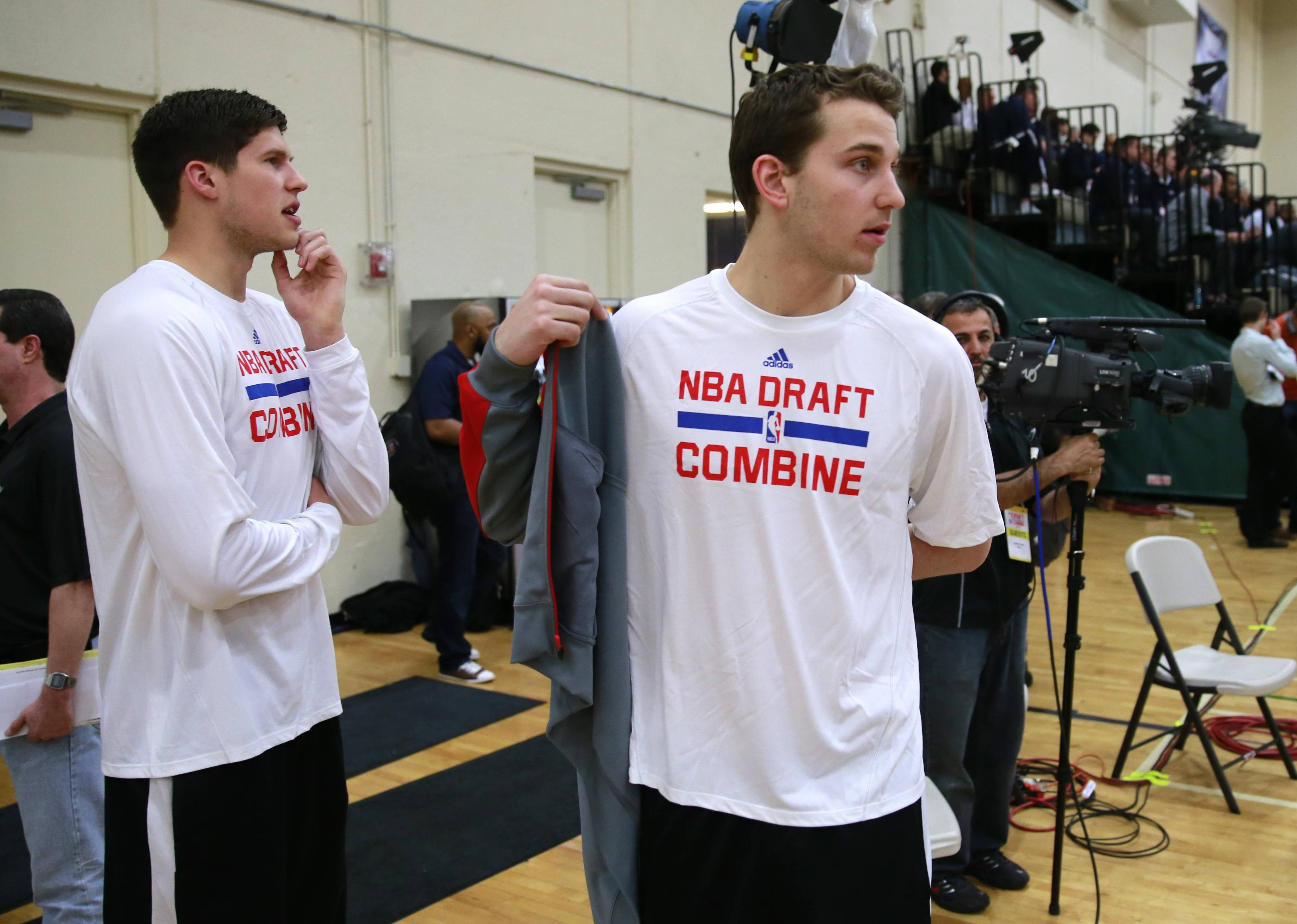 Nik Stauskas from Michigan, right, and Doug McDermontt from Creighton watch players participate in the Draft Combine on Thursday. Stauskas recorded a 35.5-inch vertical jump and could be a nice addition to the Bulls as a long-range shooter.