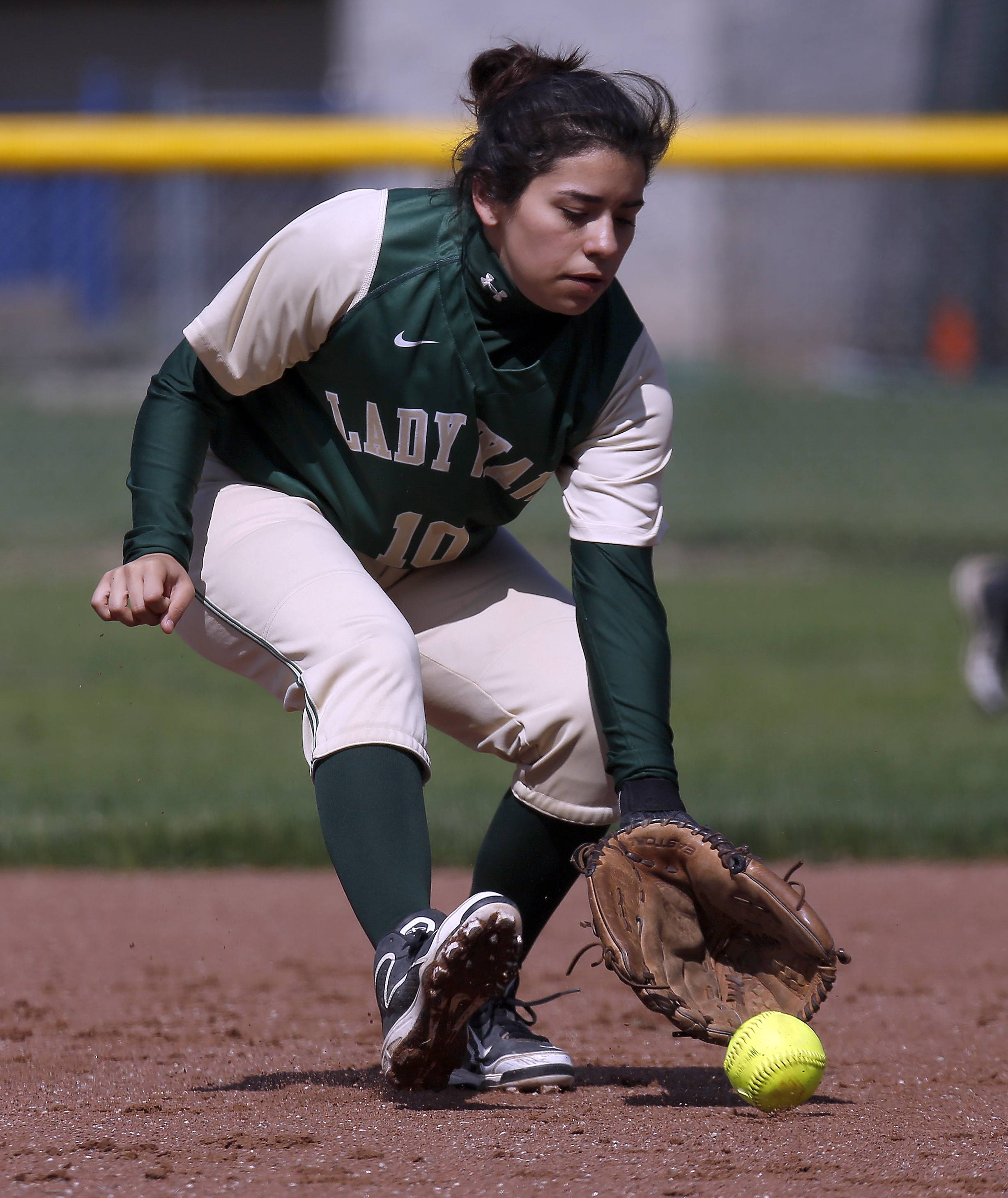 St. Edward second baseman Jasmine Deleon picks up a groundball against Indian Creek at Judson University in Elgin Saturday.