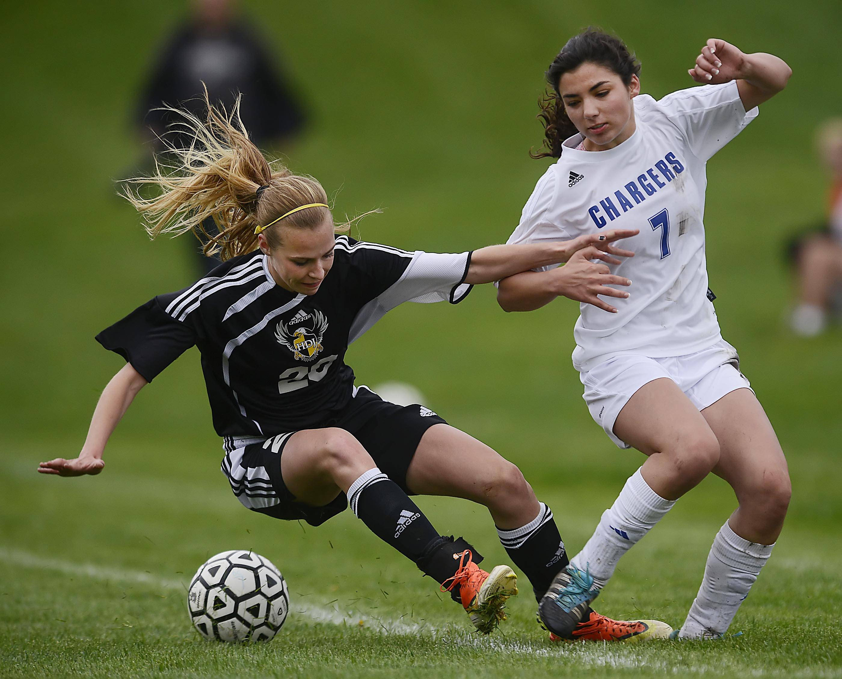 Jacobs' Heather Hoffmann falls to the turf after colliding with Dundee-Crown's Franki Scarpelli.