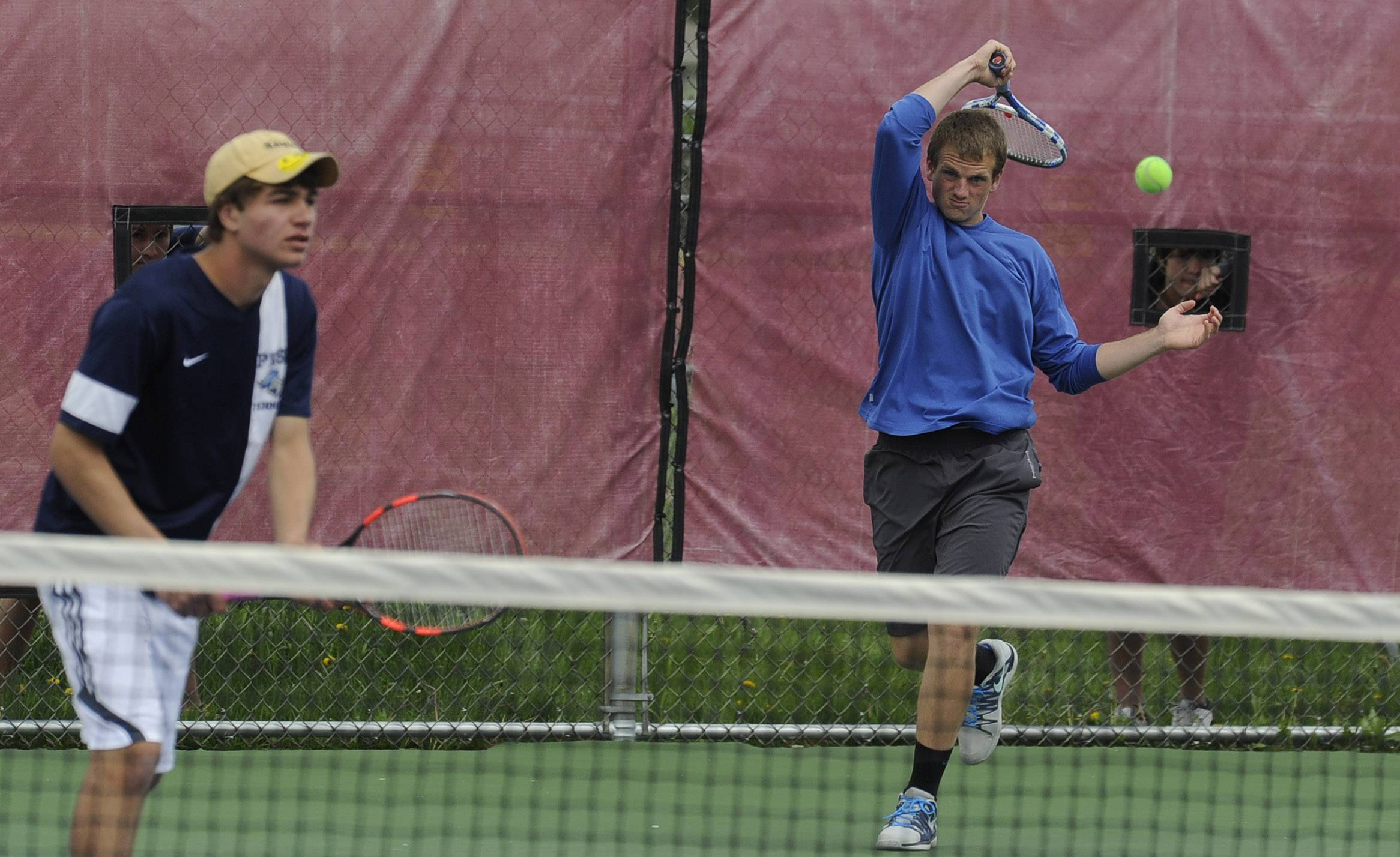 Prospect's Sam Tambeaux returns a smash as his doubles partner Ralph Tenuta looks on during Saturday's Mid-Suburban League touranment at Schaumburg.