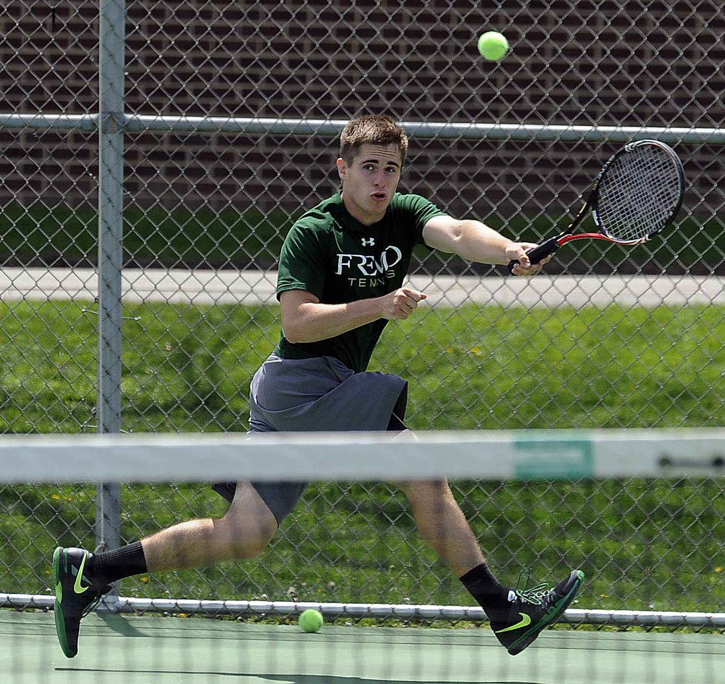 Fremd's Eric Pohl battles against Rolling Meadows' Mack Galvin in Mid-Suburban League singles play Saturday at Schaumburg.