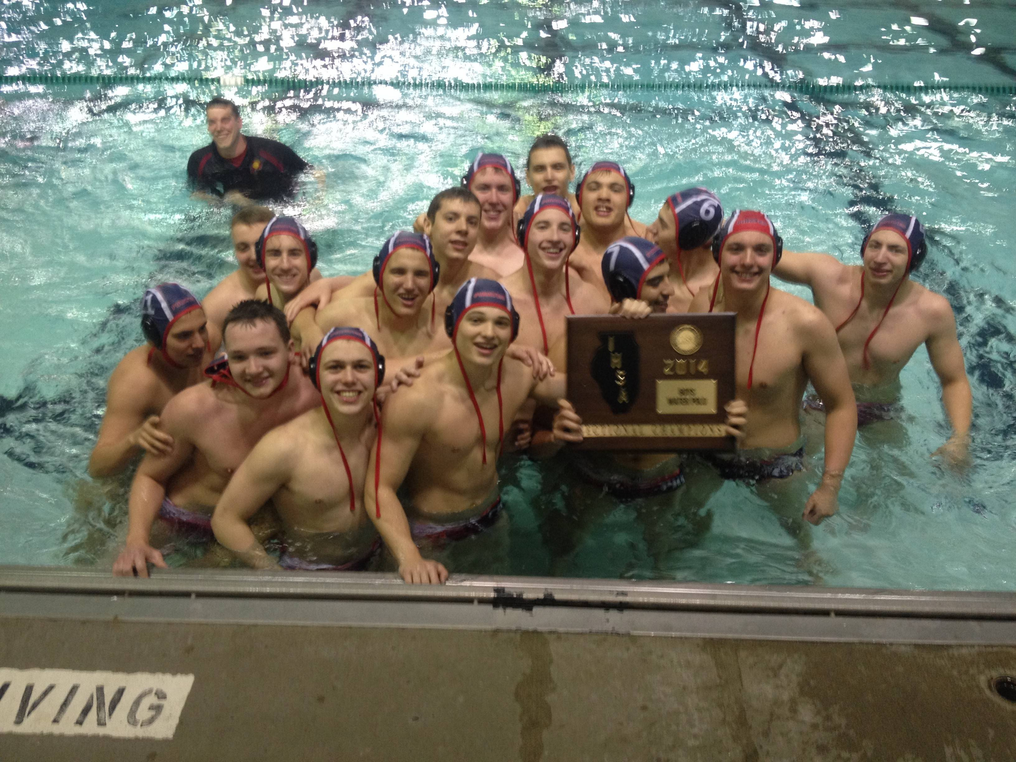 Palatine's boys water polo team celebrates its 12-10 victory against Fremd in Saturday's sectional championship game.