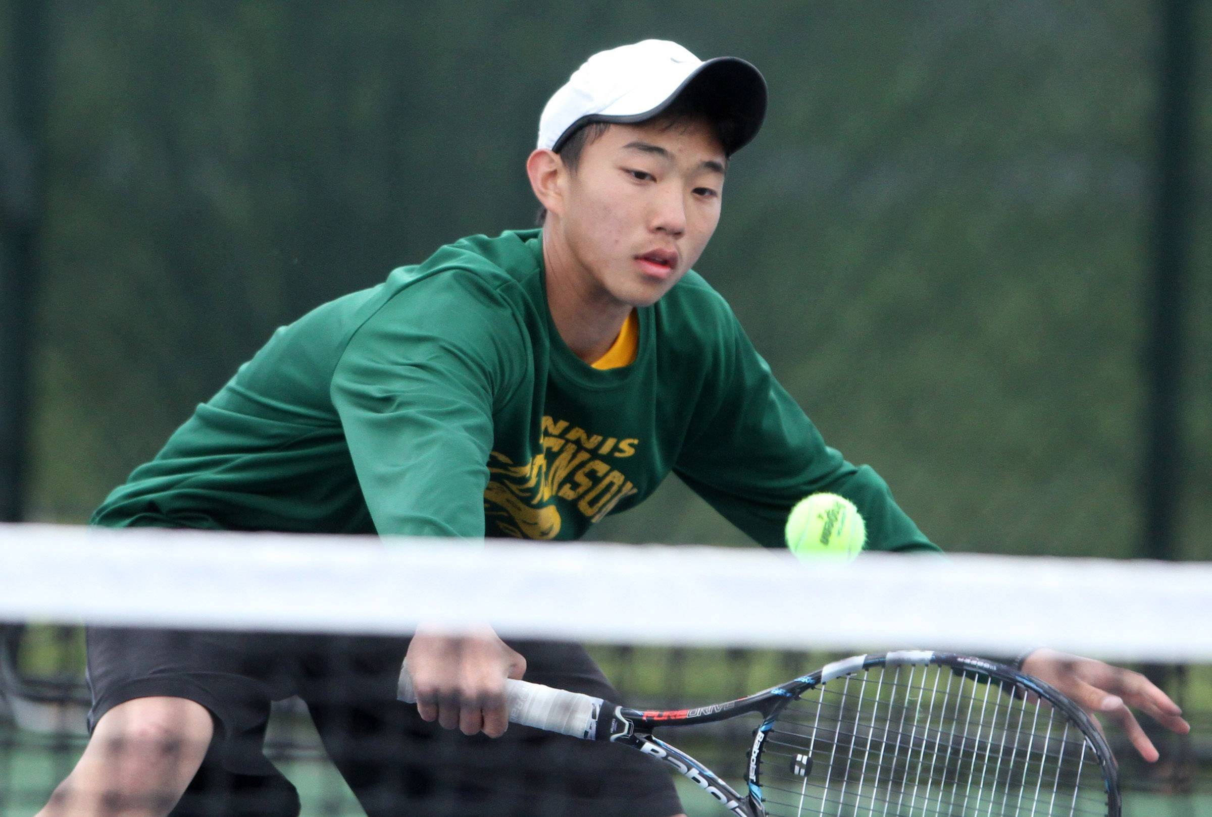 Stevenson's Josh Cheng playing doubles with Lukasz Jaworski against Lake Forest's Parker Marsh and Ben Kasbeer during Saturday's North Suburban Conference tournament in Vernon Hills.