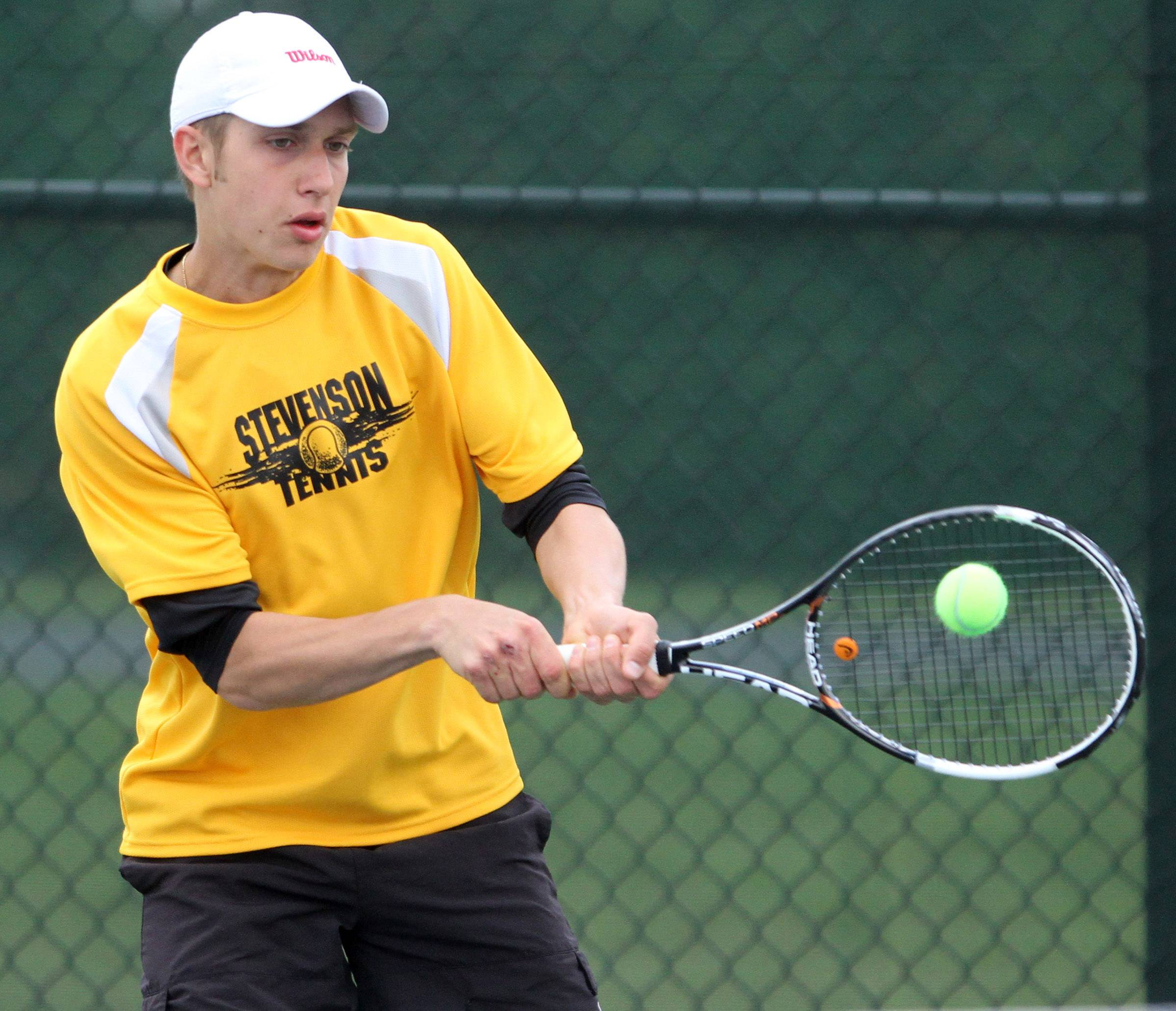 Stevenson's Lukasz Jaworski playing doubles with Josh Cheng against Lake Forest's Parker Marsh and Ben Kasbeer during Saturday's North Suburban Conference tournament in Vernon Hills.