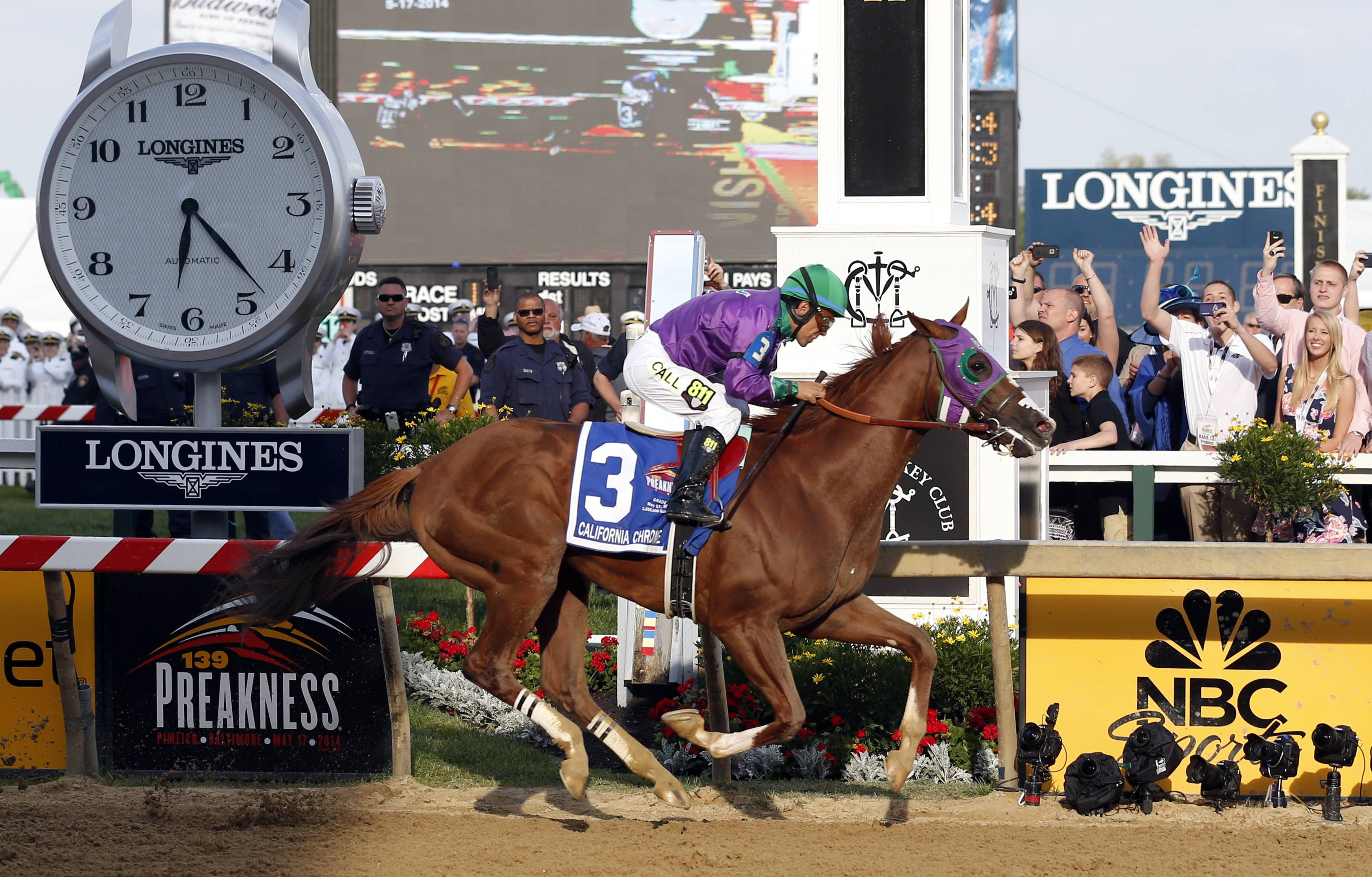 California Chrome, ridden by jockey Victor Espinoza, wins the 139th Preakness Stakes horse race at Pimlico Race Course Saturday in Baltimore.