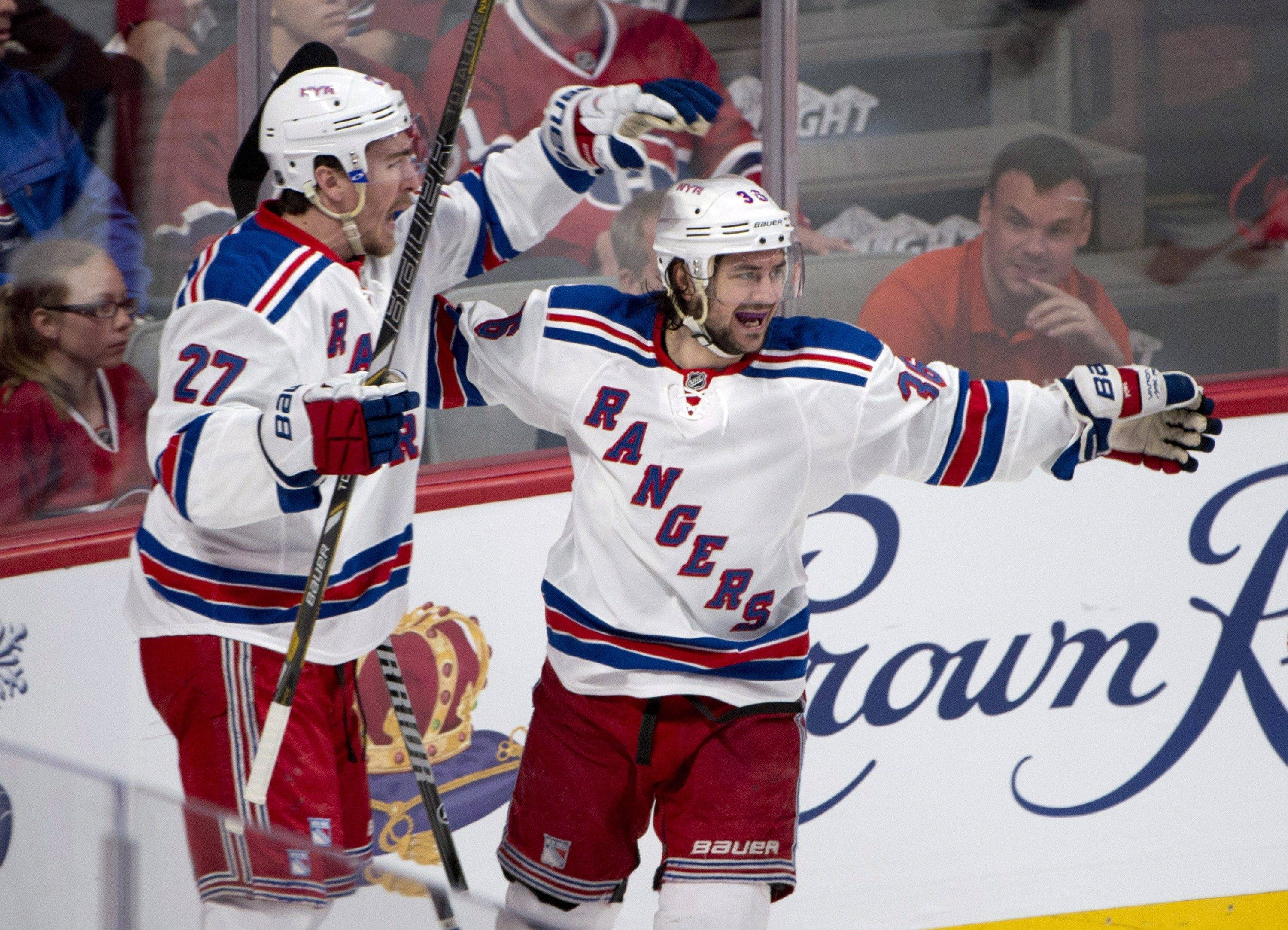 New York Rangers defenseman Ryan McDonagh, left, and left wing Mats Zuccarello celebrate after Zuccarello scored against the Montreal Canadiens during the first period in Game 1 of the Eastern Conference finals in the NHL hockey Stanley Cup playoffs in Montreal on Saturday, May 17, 2014. (AP Photo/The Canadian Press, Adrian Wyld