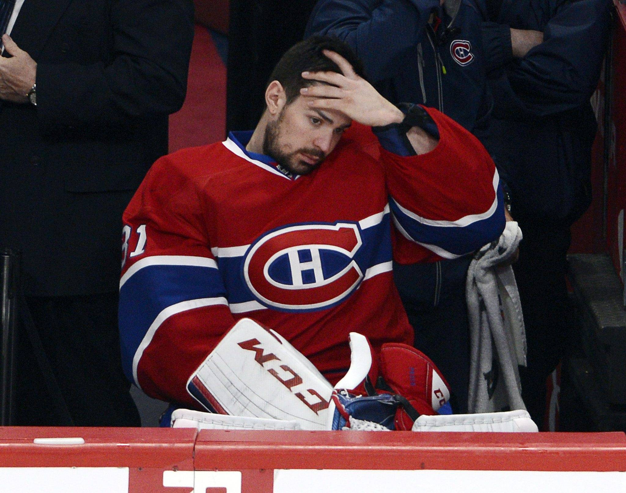 Montreal Canadiens goalie Carey Price (31) watches from the bench during the third period in Game 1 of the Eastern Conference finals in the NHL hockey Stanley Cup playoffs in Montreal on Saturday, May 17, 2014. The Rangers won 7-2.