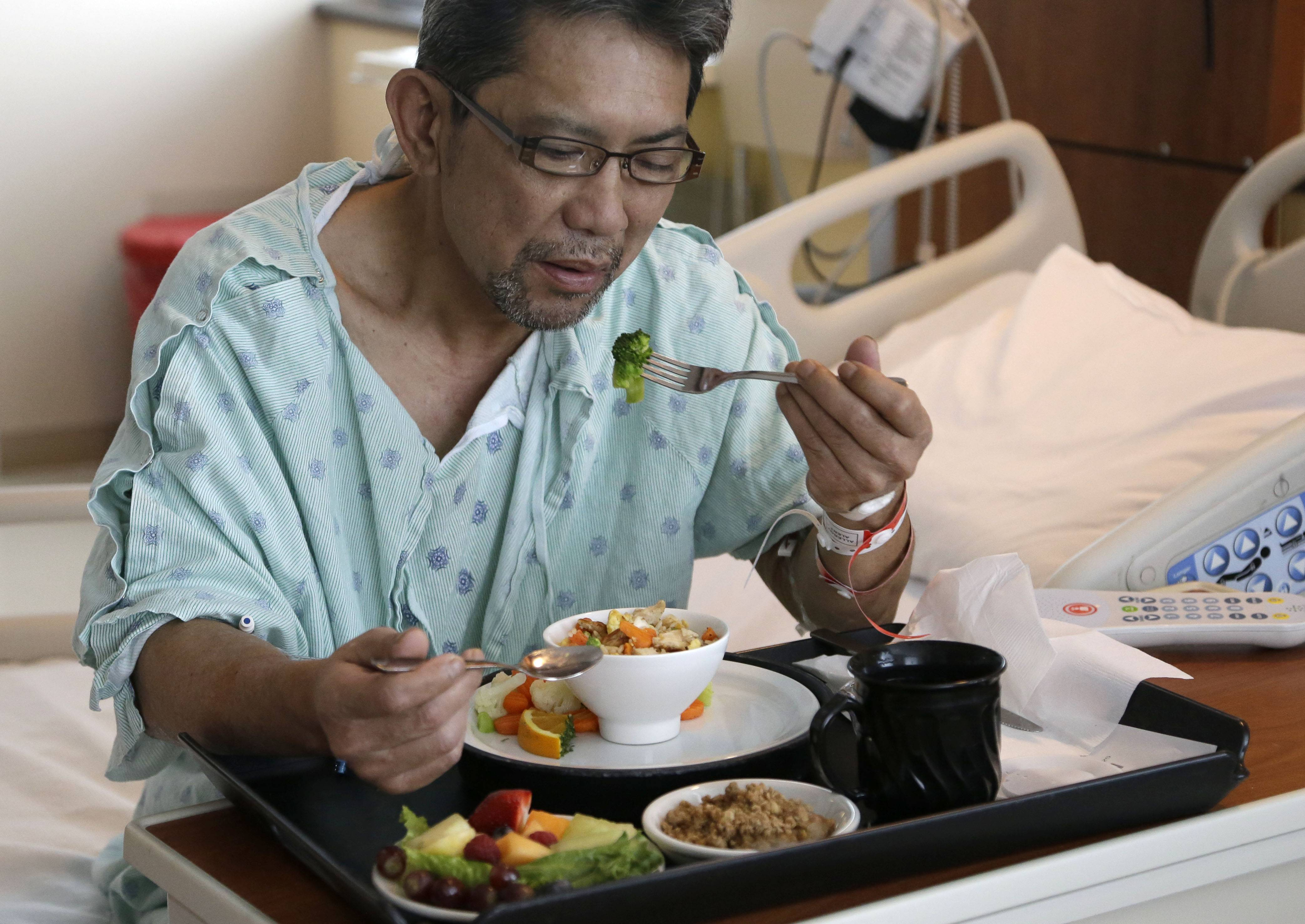 Heart patient Nhan Luong eats a heart healthy lunch of chicken fried rice, vegetables, fruit and dessert Thursday, May 1, 2014, at Houston's Memorial Hermann Southwest Hospital. Menu changes are one way to care for an increasingly diverse population that hails from regions once not typical to the Houston area.