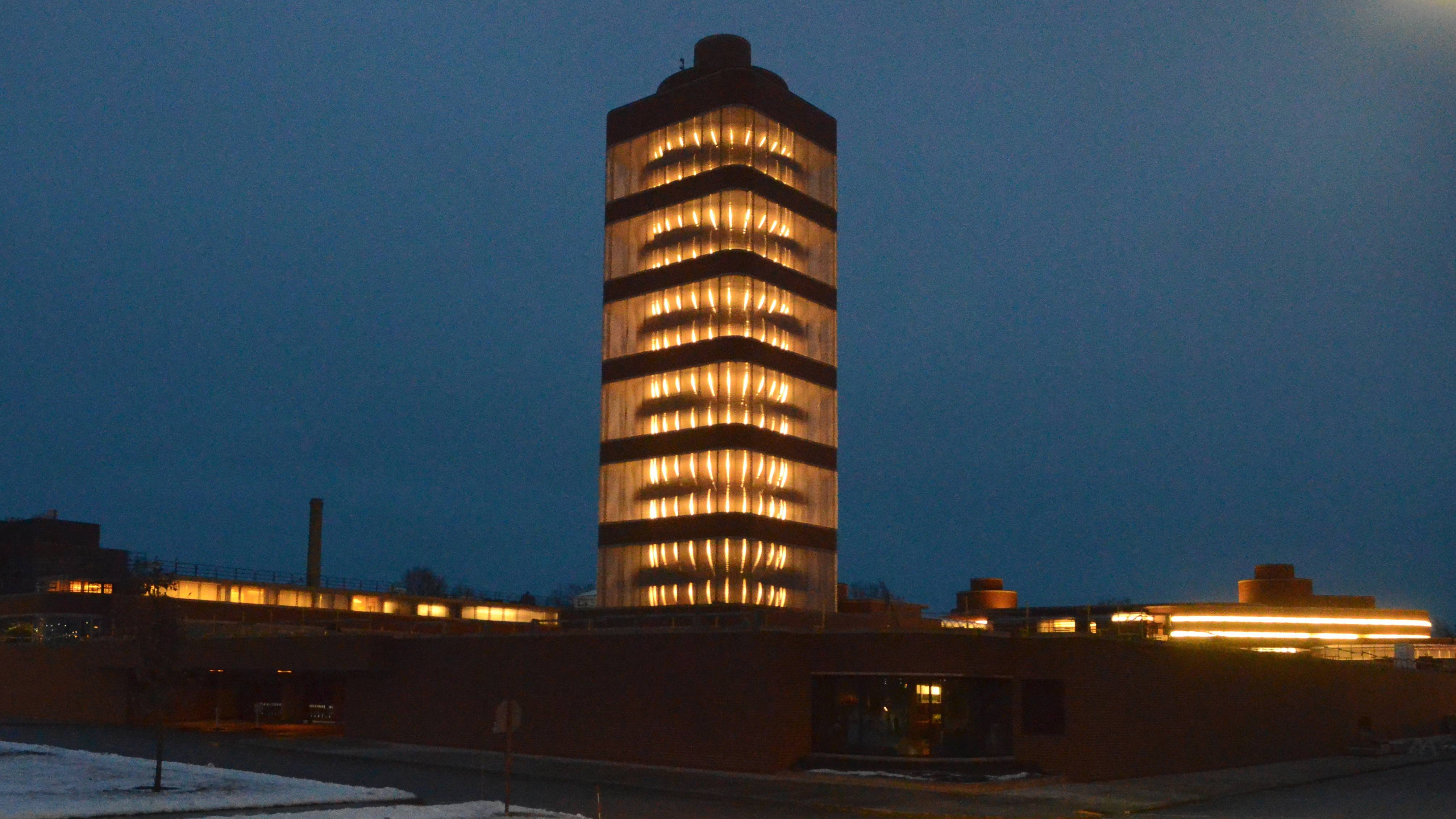 This Dec. 21, 2013 photo provided by SC Johnson shows the SC Johnson Research Tower designed by Frank Lloyd Wright lit up at night in Racine, Wis. Home products giant SC Johnson is opening the building for public tours for the first time starting May 2.