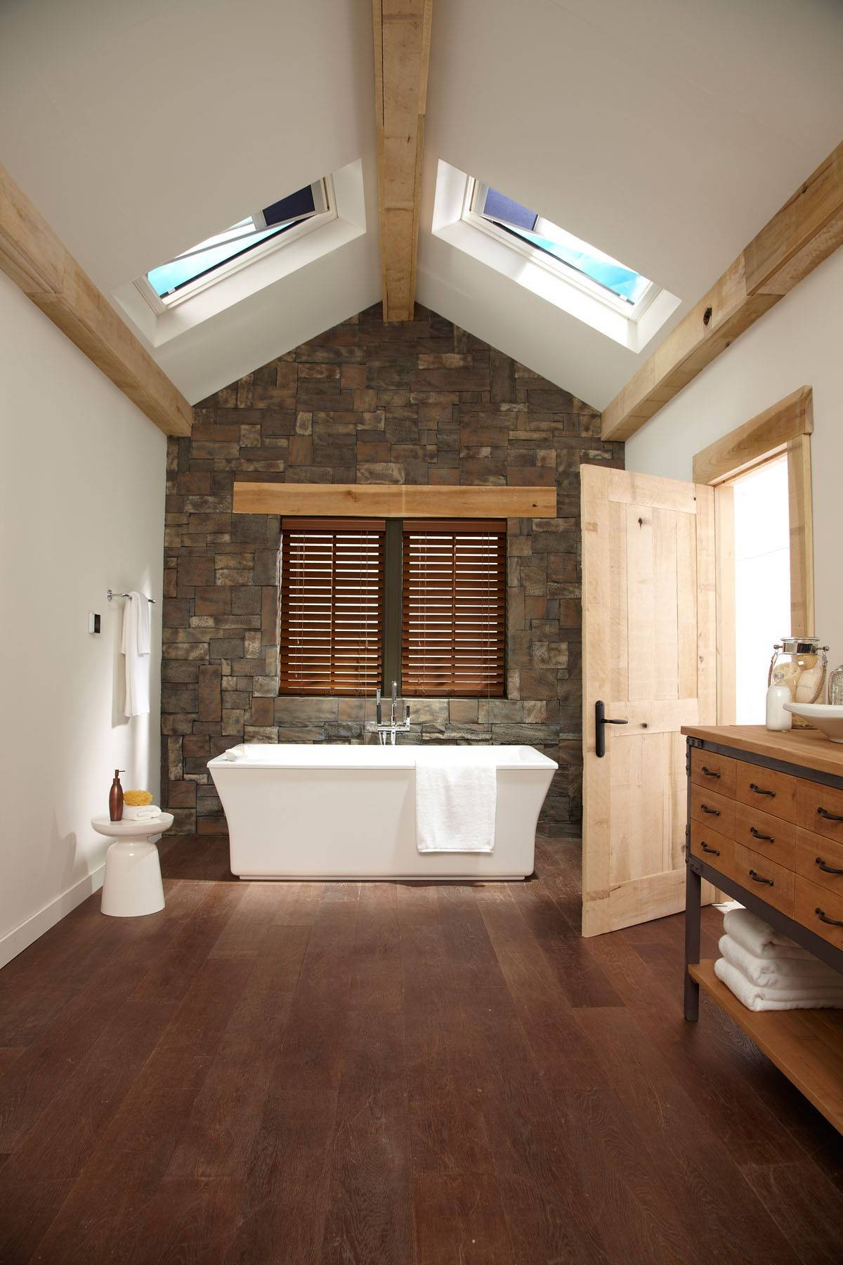 Skylights add dimension to this narrow and potentially dark bathroom.