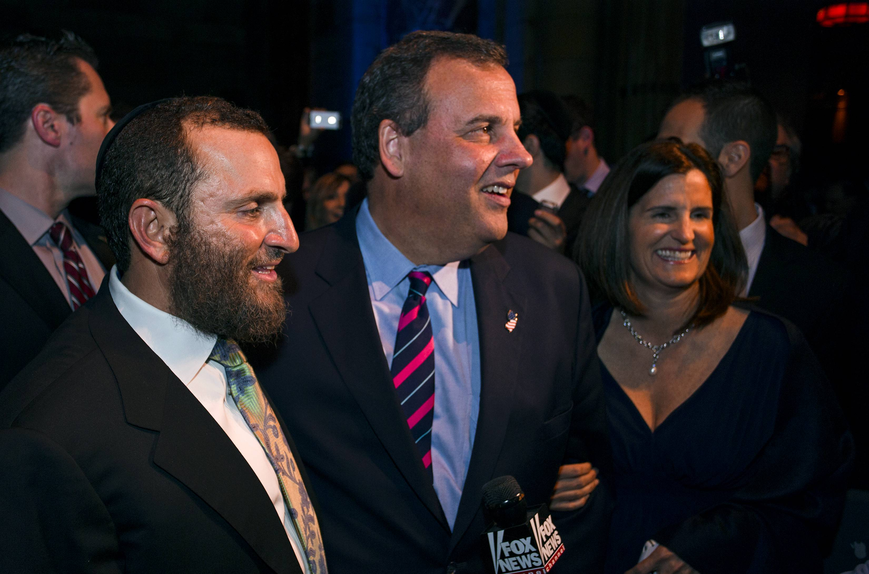 Gov. Chris Christie, center, walks with Rabbi Shumley Boteach as he attends the Champions of Jewish Values International Awards gala in New York on Sunday. At right is Christie's wife, Mary Pat.