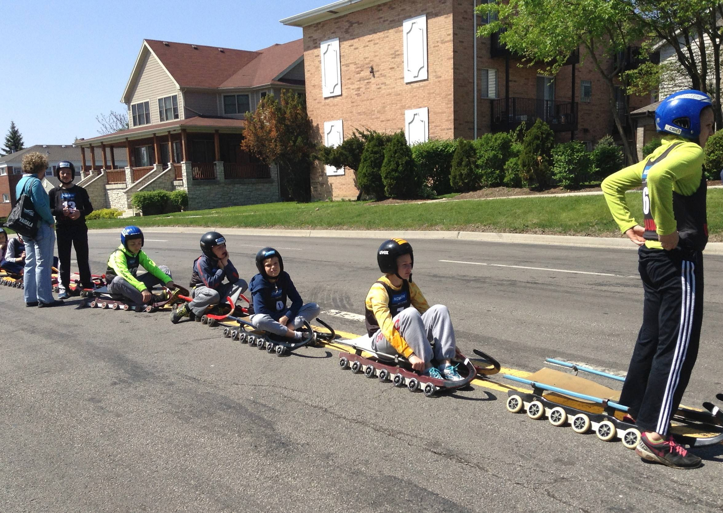 Young luge enthusiasts wait Sunday for their chance to slide down Cass Avenue in Westmont during a special summer tryout hosted by the U.S. Luge Assocation. Youngsters who performed well will have a chance to earn a spot on the U.S. Junior Luge Team.