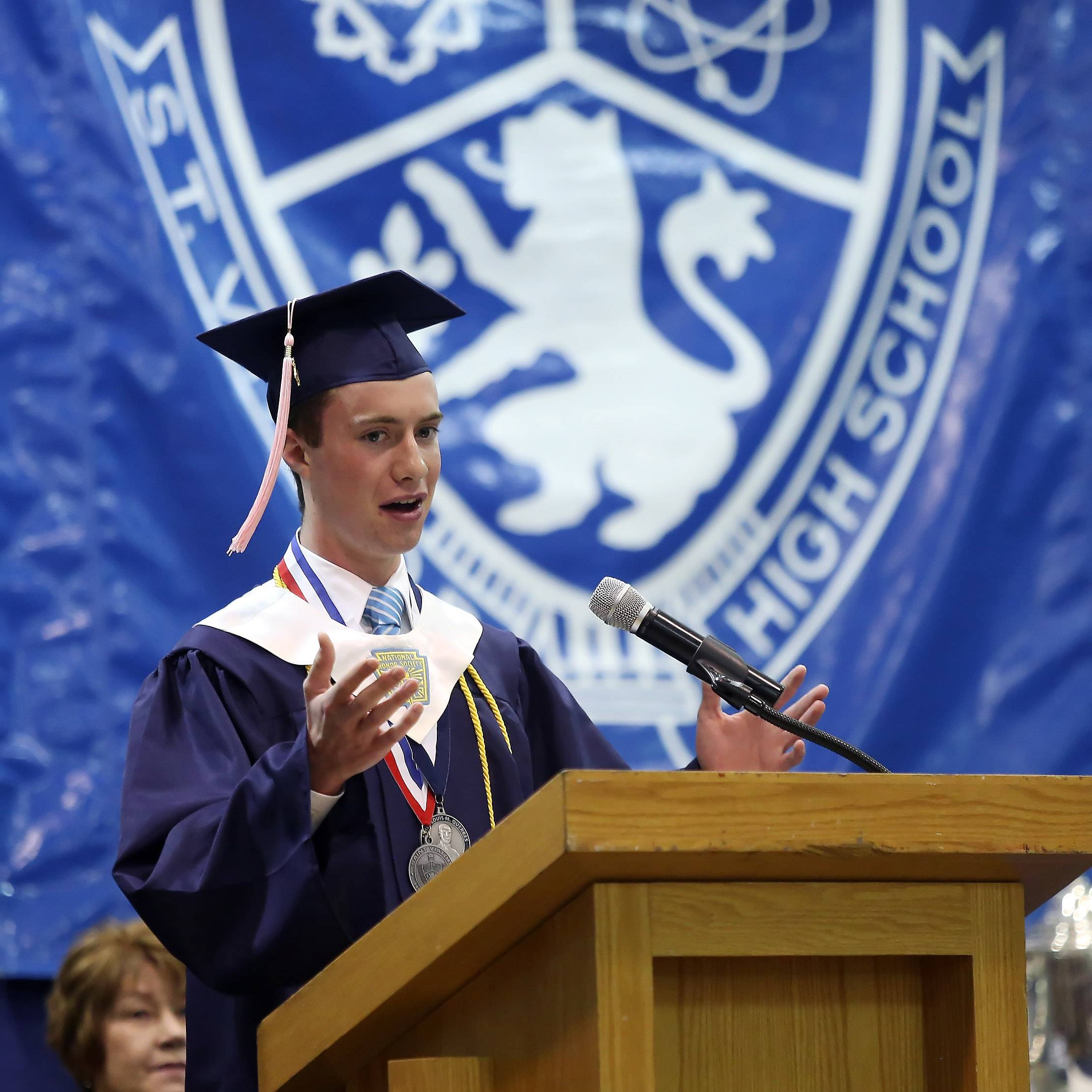 Valedictorian Tyler Harris gives his speech during the 51st Annual Commencement Sunday at St. Viator High School In Arlington Heights. There were 250 graduating seniors receiving their diplomas this year.