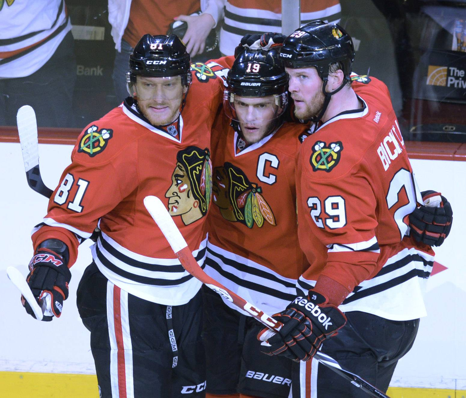 Jonathan Toews, middle, of the Chicago Blackhawks celebrates his third-period goal with teammates Marian Hossa, left, and Bryan Bickell during Sunday's game against the Los Angeles Kings at the United Center in Chicago.