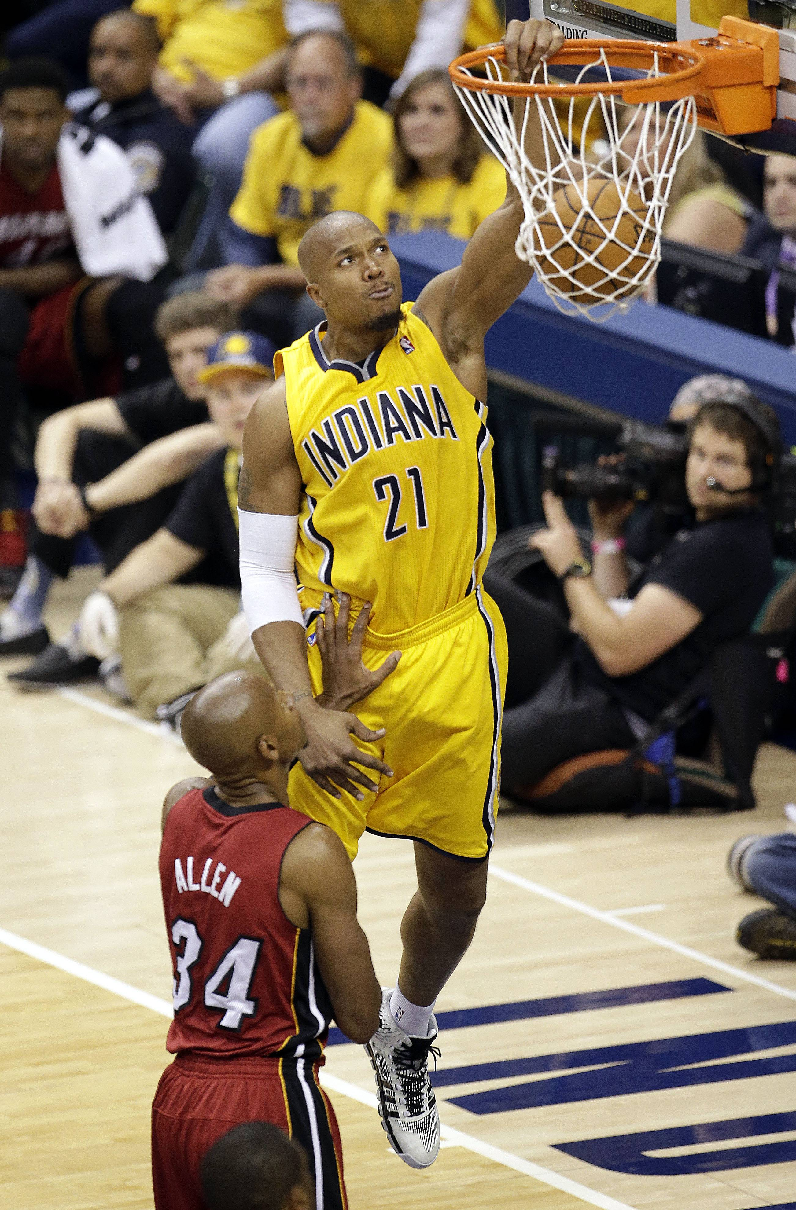 Indiana Pacers forward David West (21) dunks in front of Miami Heat guard Ray Allen (34) during the second half of Game 1 of the Eastern Conference finals NBA basketball playoff series, Sunday, May 18, 2014, in Indianapolis.The pacers won 107-96. West had 19 points.