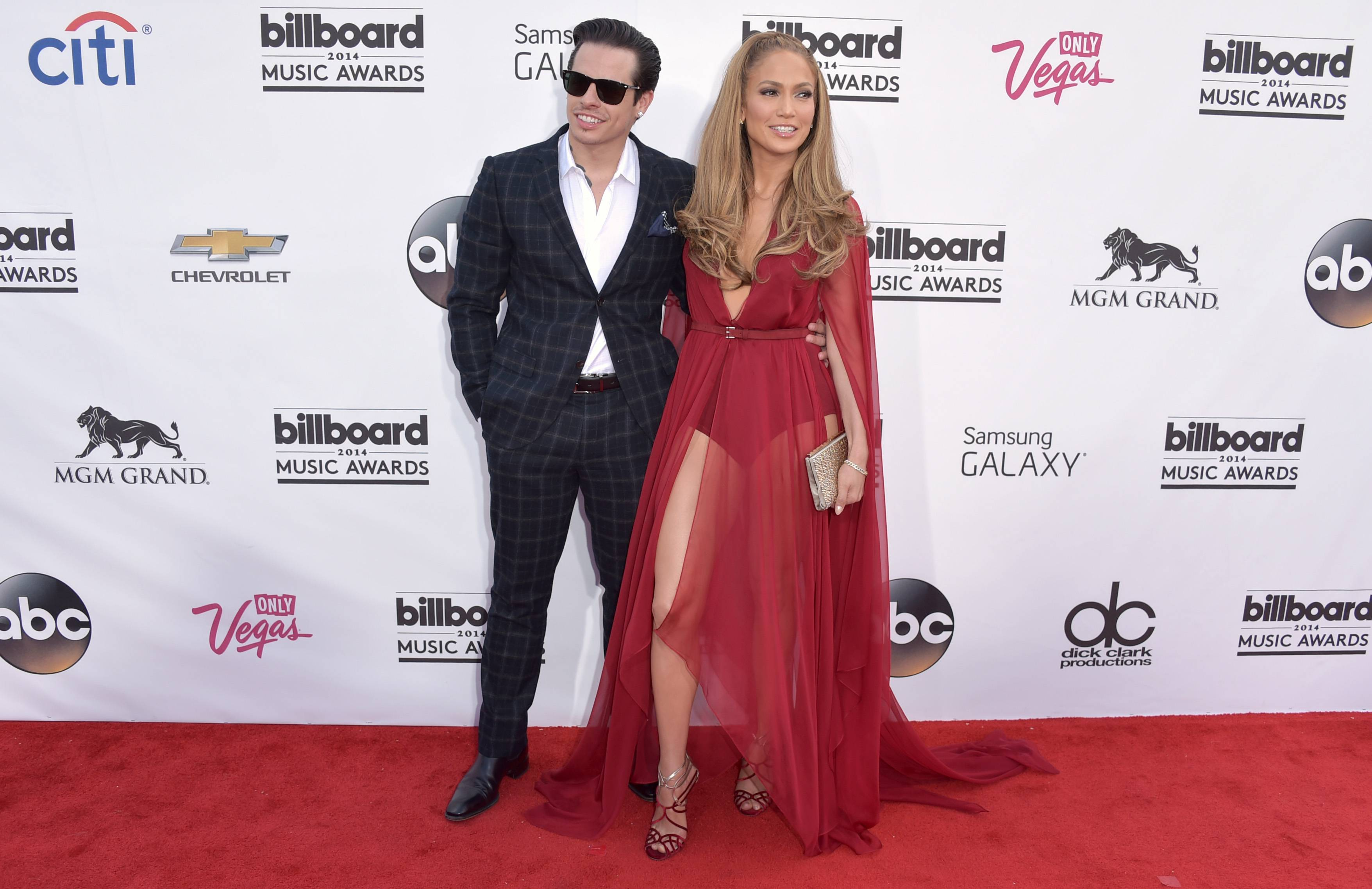 Casper Smart, left, and Jennifer Lopez arrive at the Billboard Music Awards at the MGM Grand Garden Arena on Sunday, May 18, 2014, in Las Vegas.