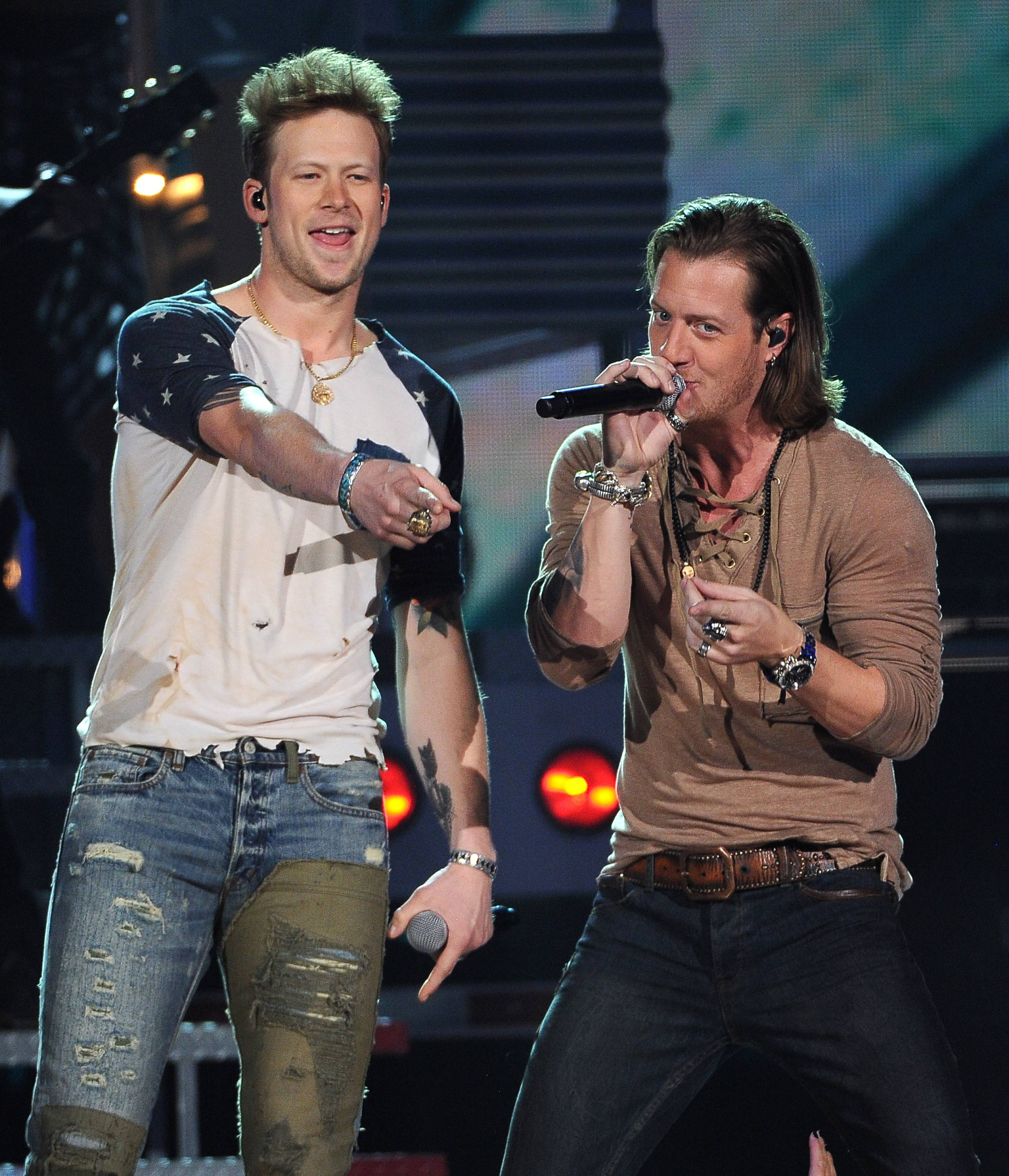 Brian Kelley, left, and Tyler Hubbard, of the musical group Florida Georgia Line, perform at the Billboard Music Awards at the MGM Grand Garden Arena on Sunday, May 18, 2014, in Las Vegas.