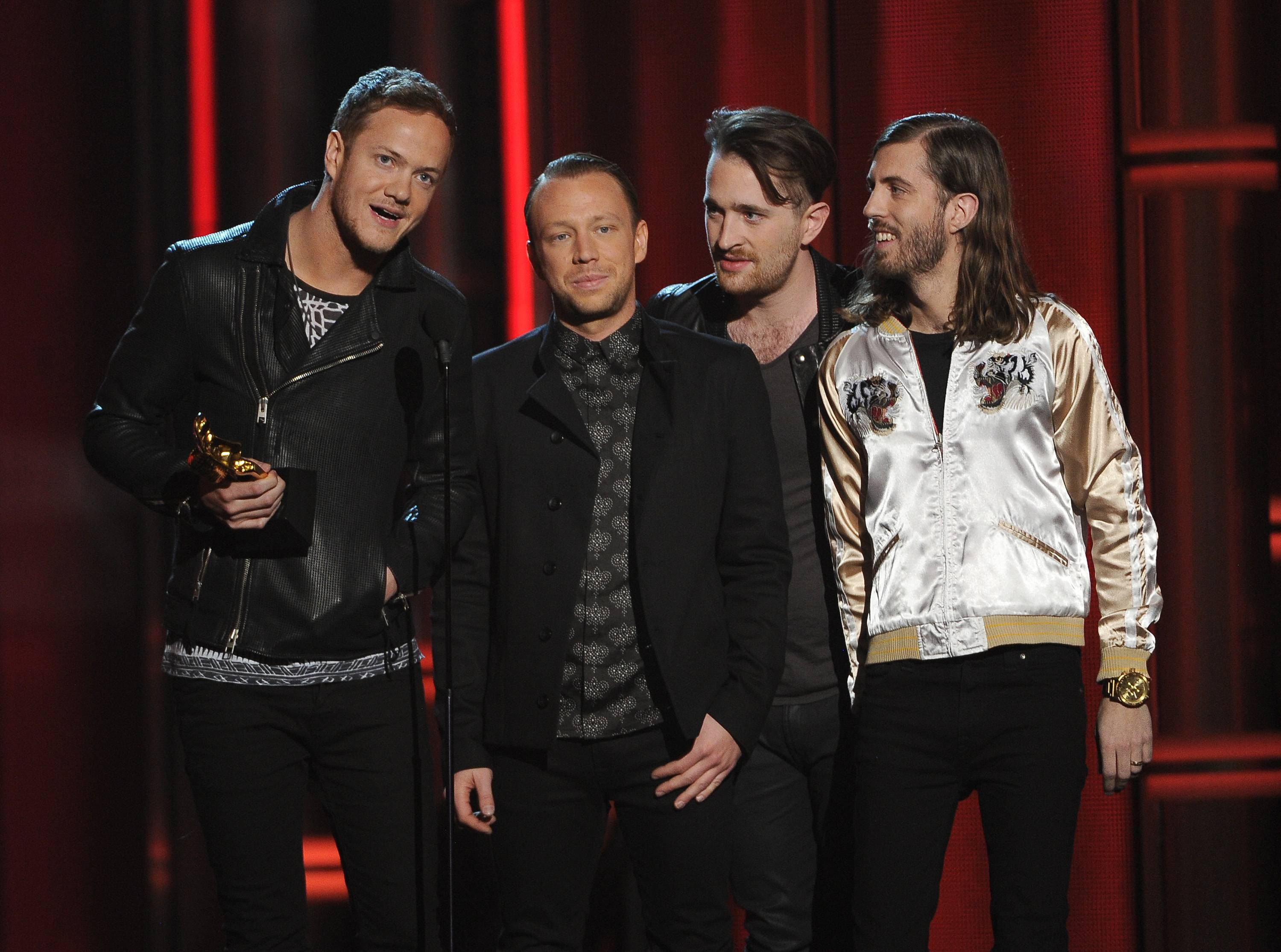 "Dan Reynolds, and from left, Ben McKee, Daniel Platzman and Wayne Sermon, of the musical group Imagine Dragons, accept the award for top rock album-for ""Night Vision"" at the Billboard Music Awards at the MGM Grand Garden Arena on Sunday, May 18, 2014, in Las Vegas."