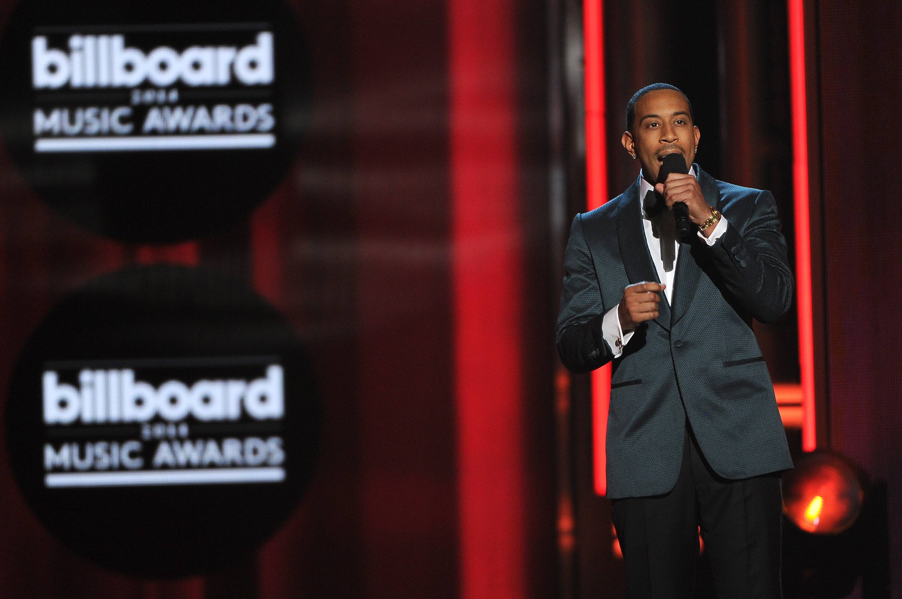 Ludacris, host of the Billboard Music Awards, speaks on stage at the MGM Grand Garden Arena on Sunday, May 18, 2014, in Las Vegas.