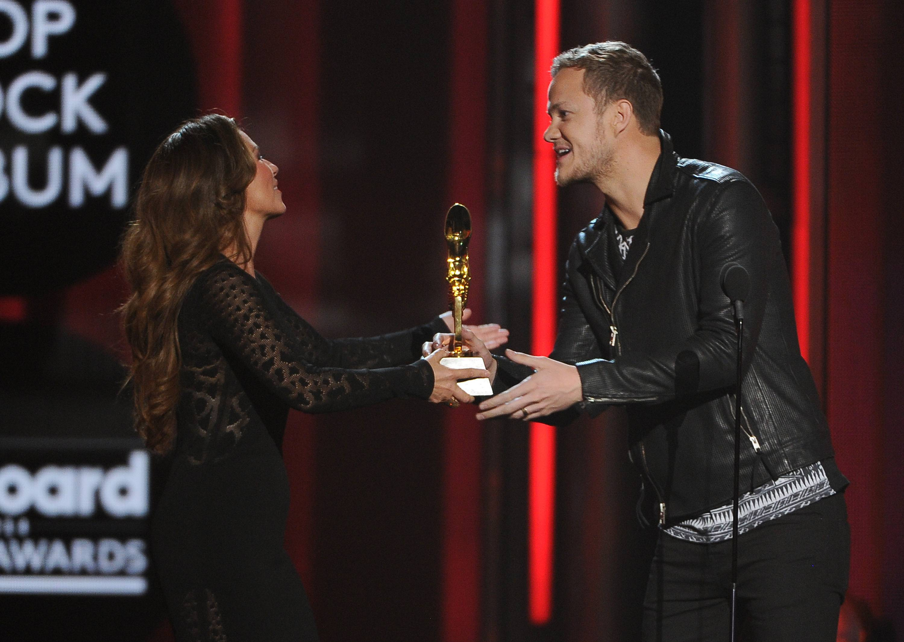 Shania Twain, left, presents the award for top rock album to Dan Reynolds, of the musical group Imagine Dragons,  at the Billboard Music Awards at the MGM Grand Garden Arena on Sunday, May 18, 2014, in Las Vegas.