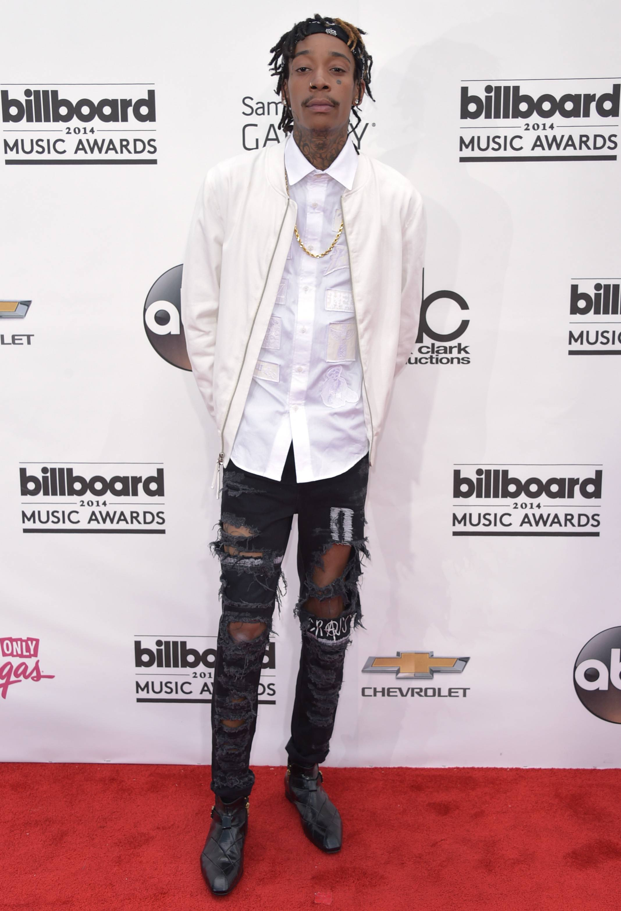 Wiz Khalifa arrives at the Billboard Music Awards at the MGM Grand Garden Arena on Sunday, May 18, 2014, in Las Vegas.