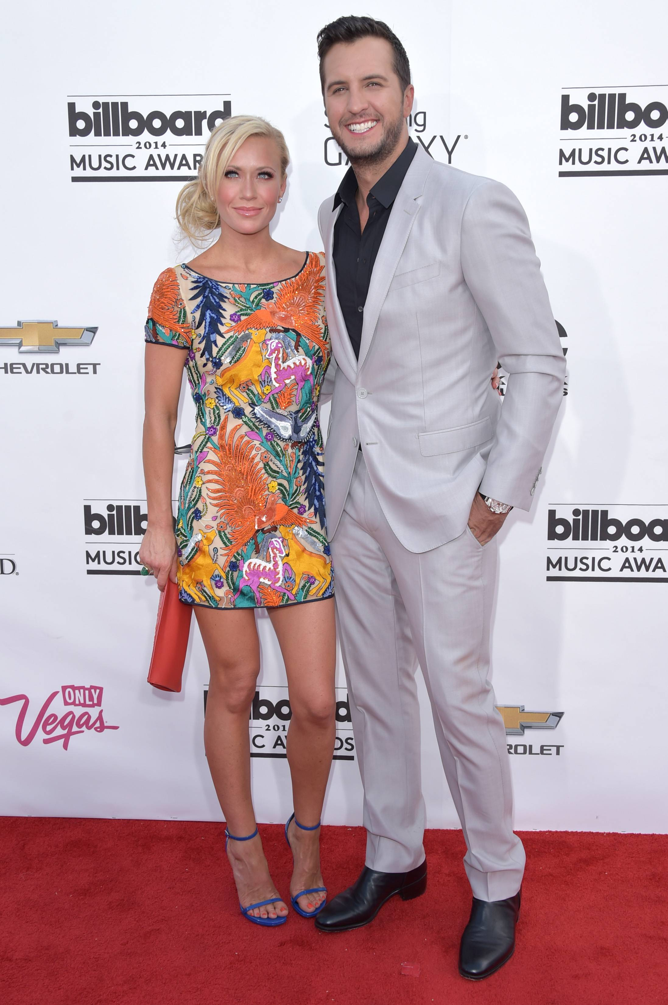 Caroline Boyer, left, and Luke Bryan arrive at the Billboard Music Awards at the MGM Grand Garden Arena on Sunday, May 18, 2014, in Las Vegas.