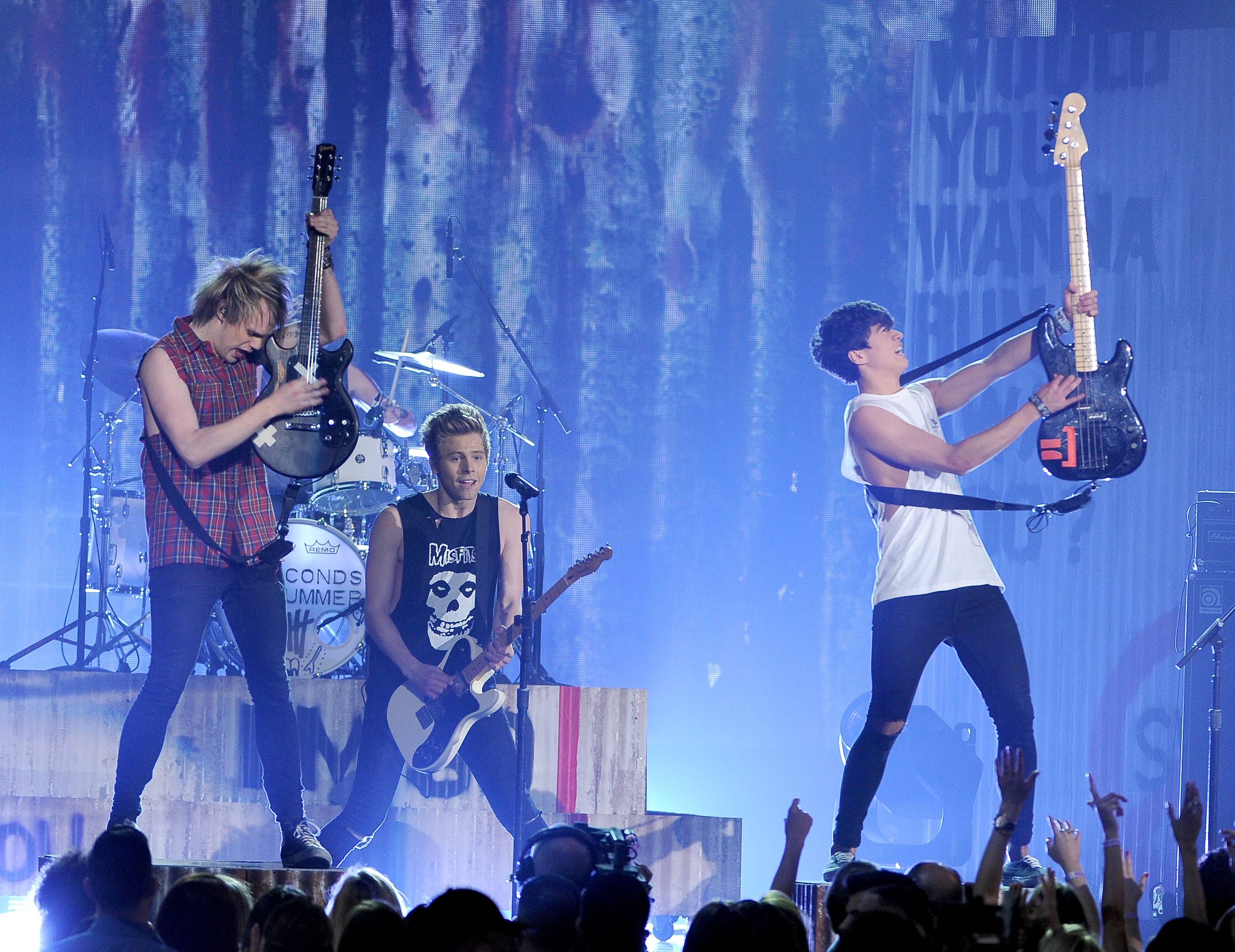 Michael Clifford, from left, Luke Hemmings and Calum Hood, of the musical group 5 Seconds of Summer, perform on stage at the Billboard Music Awards at the MGM Grand Garden Arena on Sunday, May 18, 2014, in Las Vegas.
