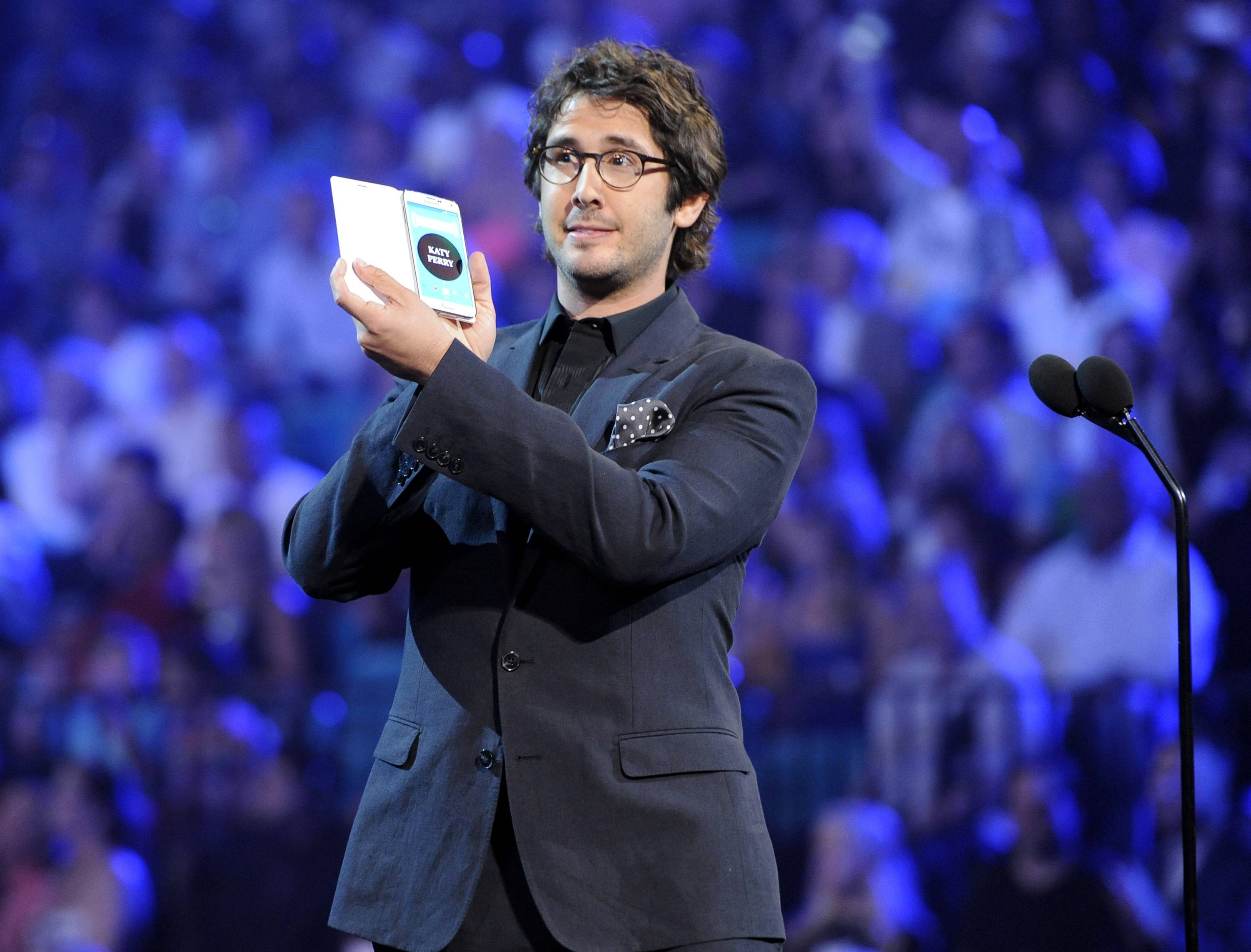 Josh Groban presents the award for top female artist to Katy Perry at the Billboard Music Awards at the MGM Grand Garden Arena on Sunday, May 18, 2014, in Las Vegas.