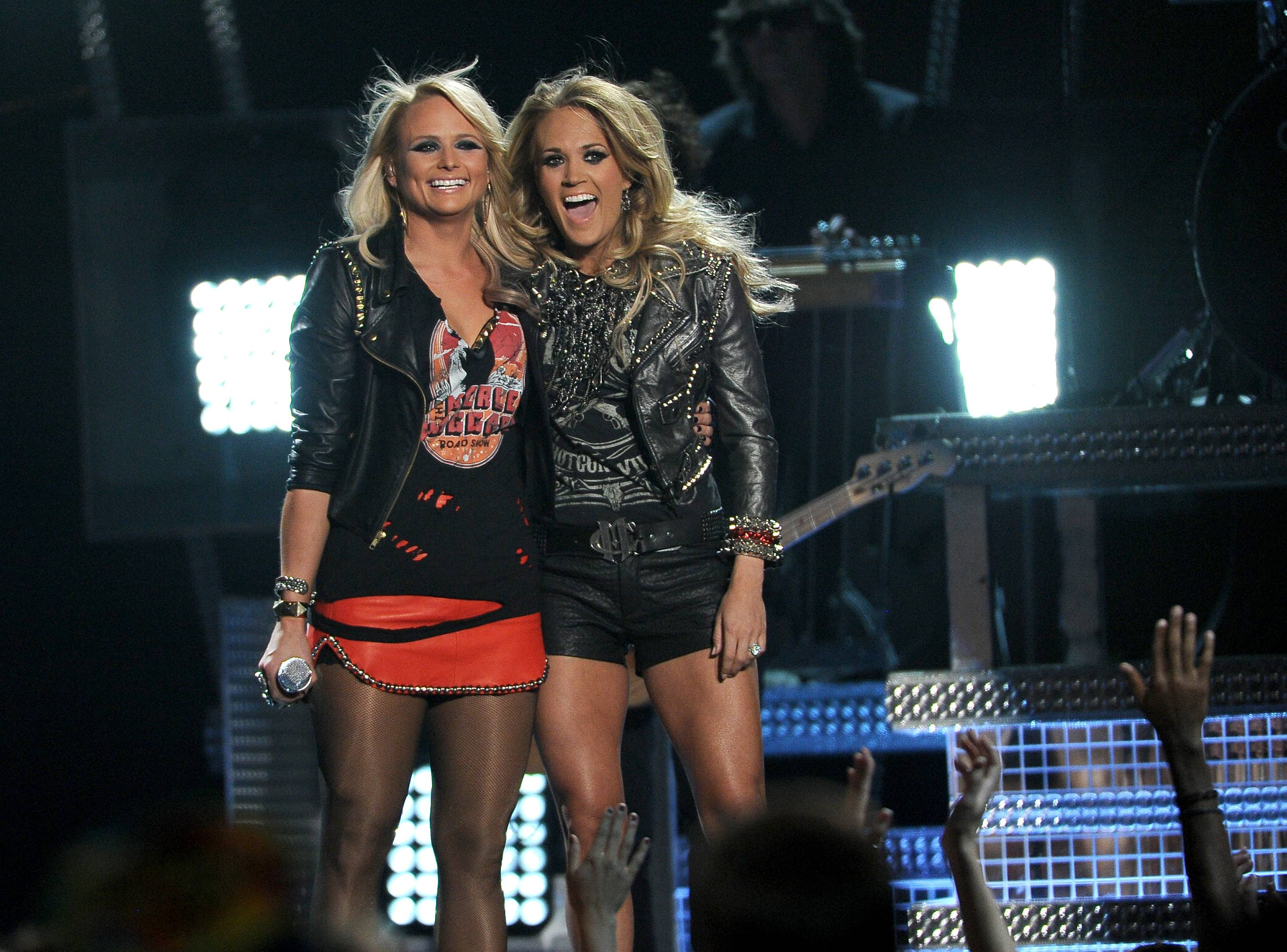 Miranda Lambert, left, and Carrie Underwood perform on stage at the Billboard Music Awards at the MGM Grand Garden Arena on Sunday, May 18, 2014, in Las Vegas.