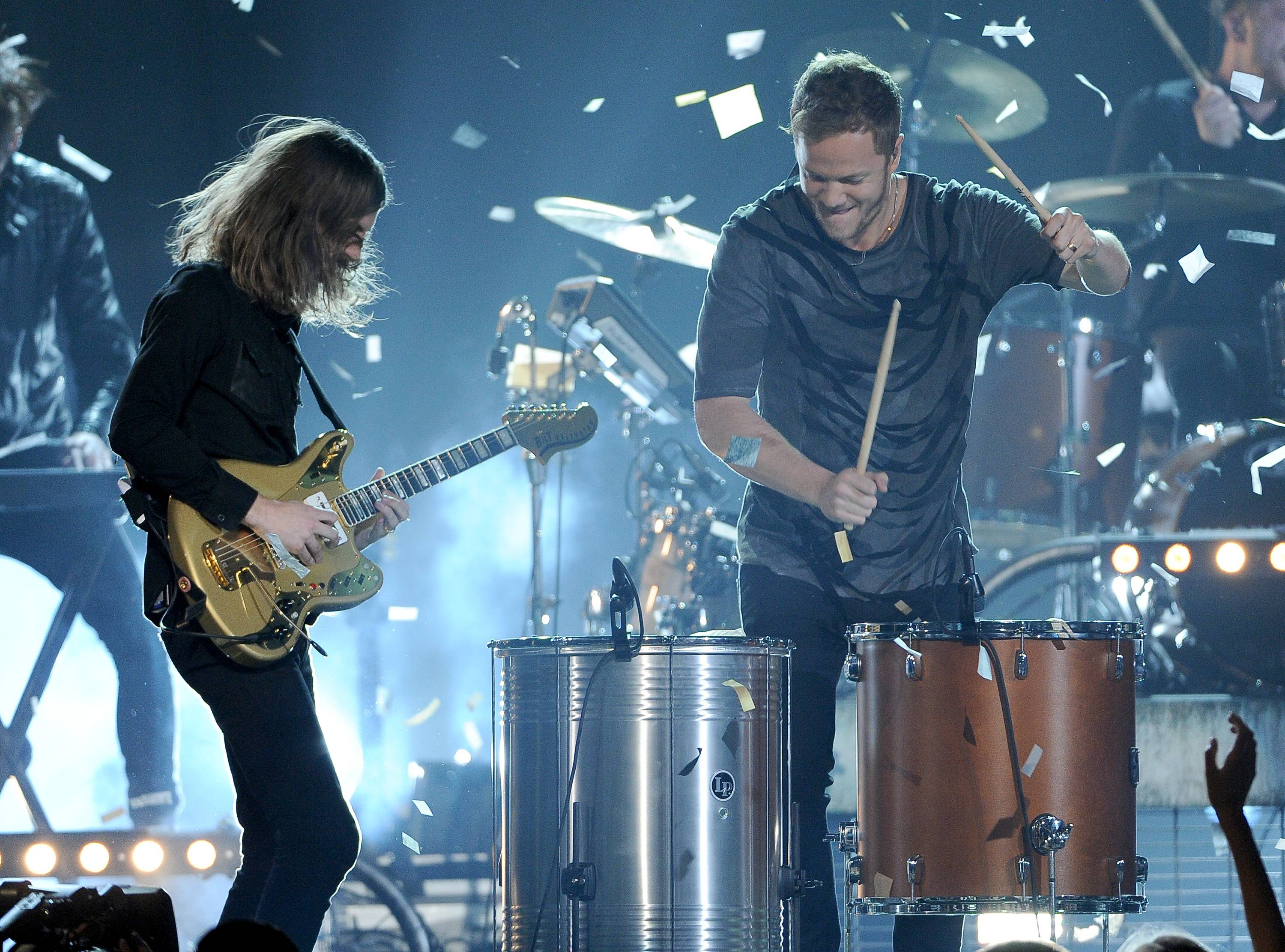 Wayne Sermon, left, and Dan Reynolds, of the musical group Imagine Dragons, perform at the Billboard Music Awards at the MGM Grand Garden Arena on Sunday, May 18, 2014, in Las Vegas.