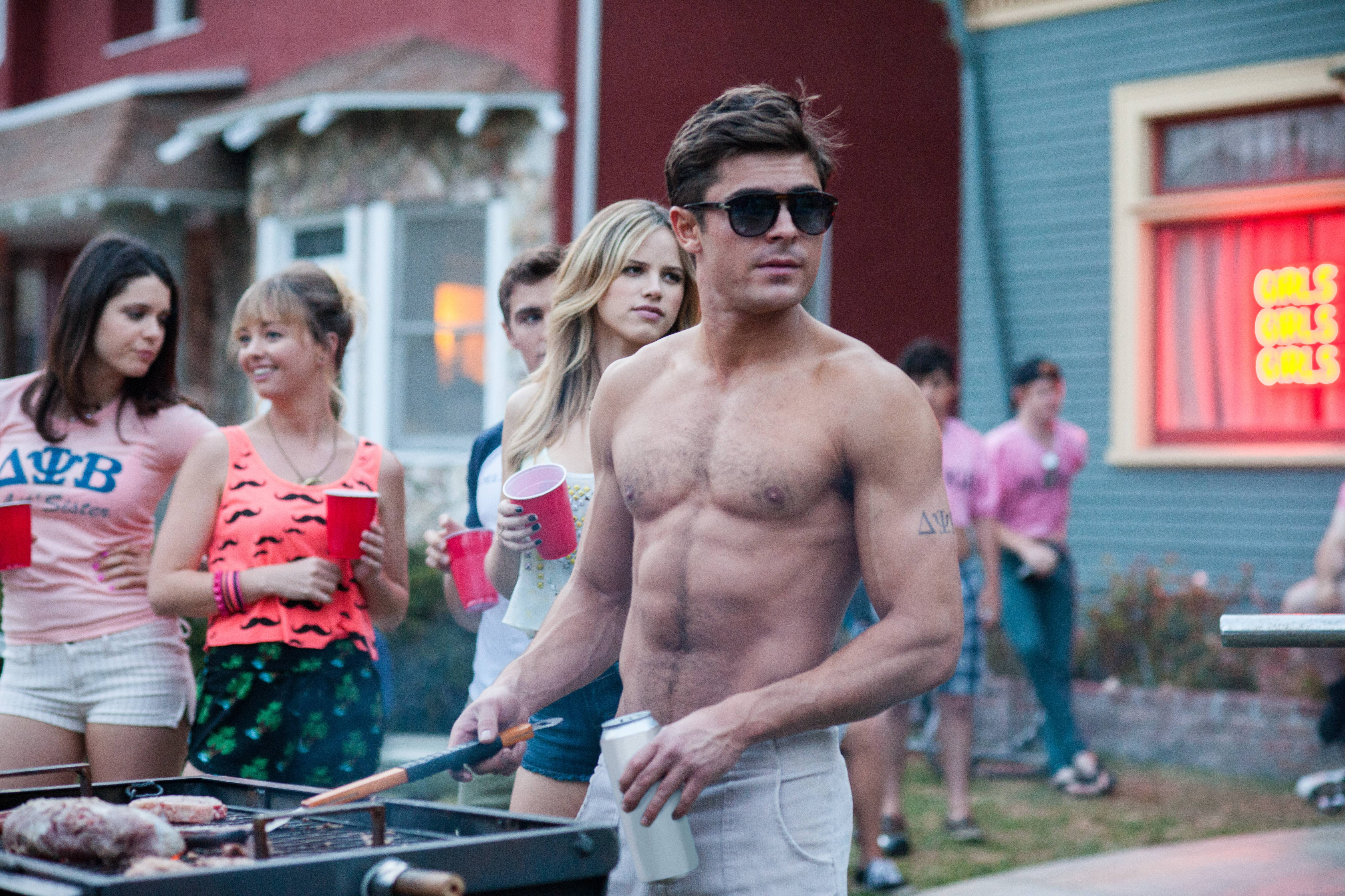 "This image released by Universal Pictures shows Zac Efron in a scene from the film, ""Neighbors,"" which fell to No. 2 at the box office with a $26 million haul."