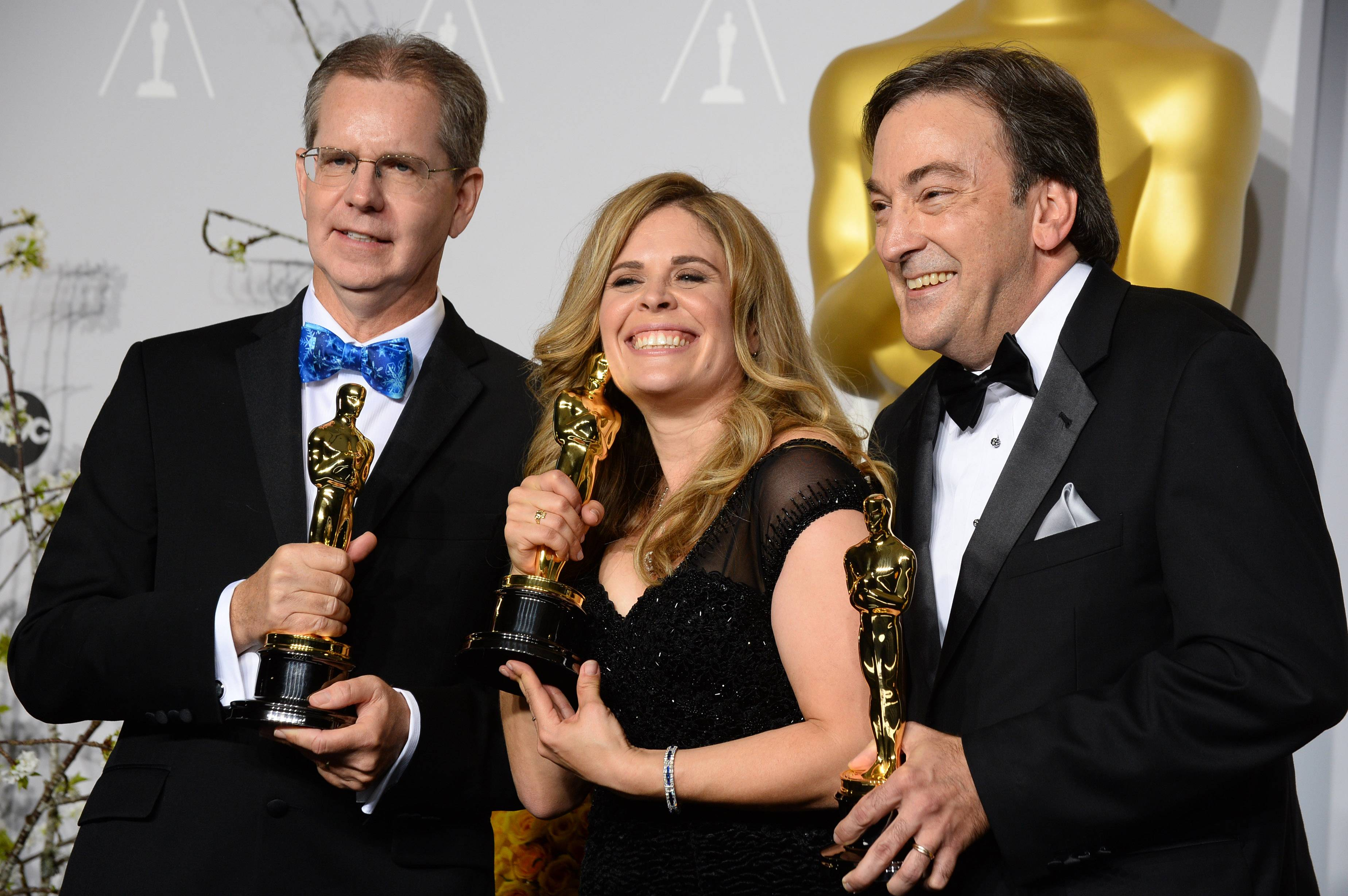 """Frozen"" director and screenwriter Jennifer Lee, center, shown here with Chris Buck, left, and Peter Del Vecho at this year's Oscars, spoke at the University of New Hampshire commencement."