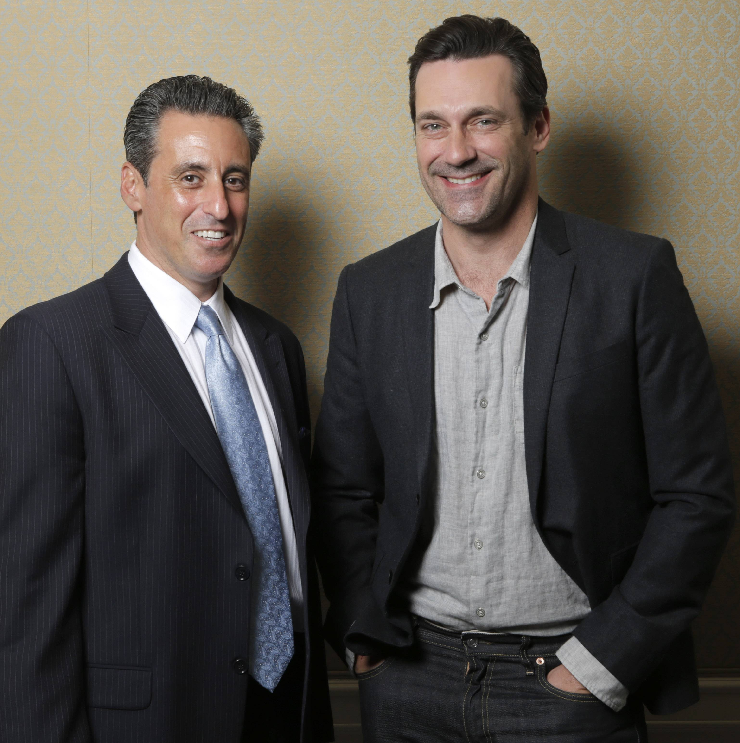 "J. B. Bernstein, left, poses with actor Jon Hamm who plays him in the film ""Million Dollar Arm,"" in Los Angeles. To portray Bernstein, the sports agent behind the signing of the first two Indian Major Leaguers,"" Hamm had to act like a noble guy in Disney's ""Million Dollar Arm"" instead of the cutthroat ad exec he embodies on TV's ""Mad Men."""