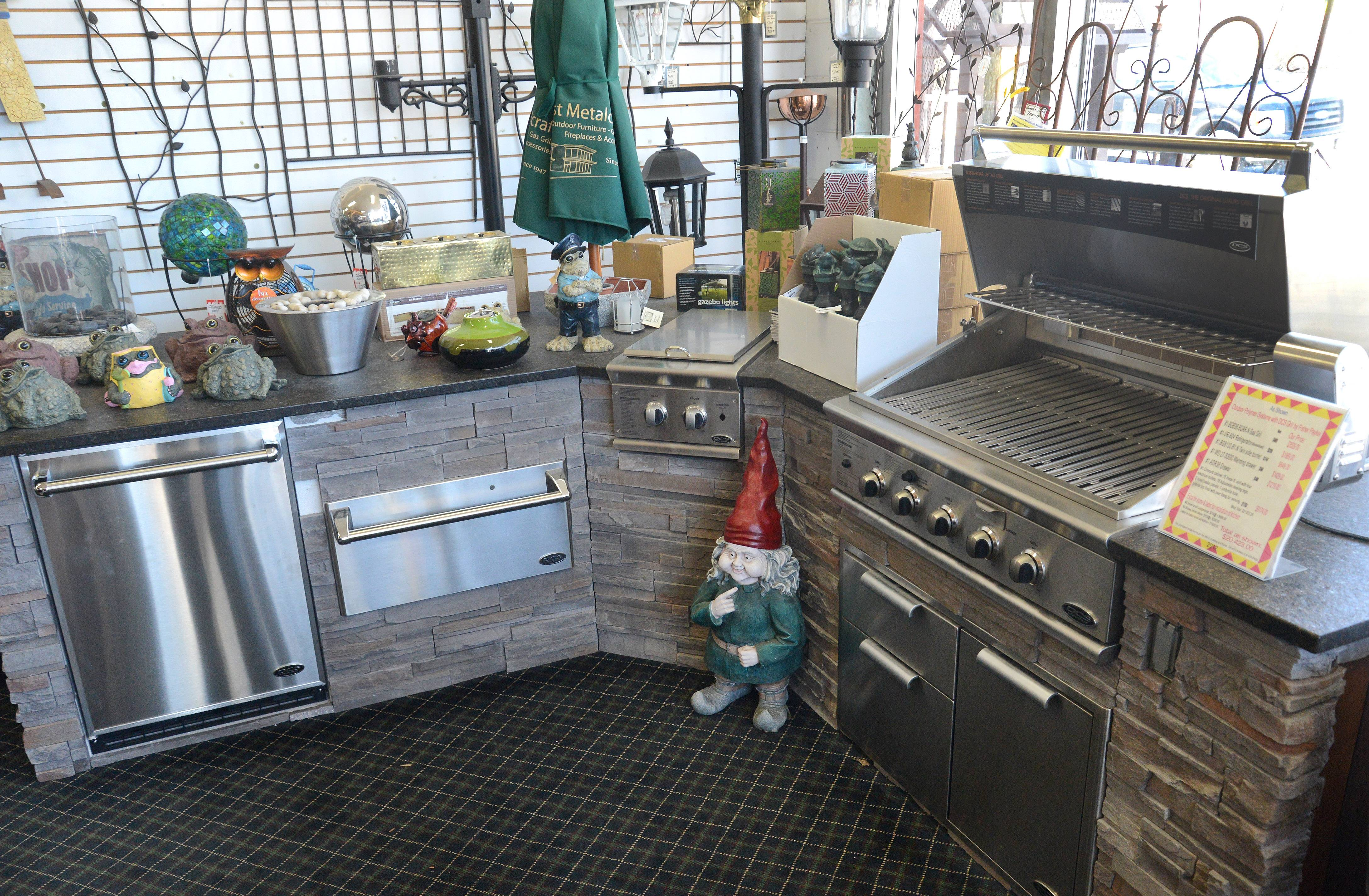 Some homeowners get so excited about cooking outdoors that they build a whole kitchen into their landscape. Pictured at Northwest Metalcraft in Arlington Heights is a setup with a Fisher Paykel DCS Grill.