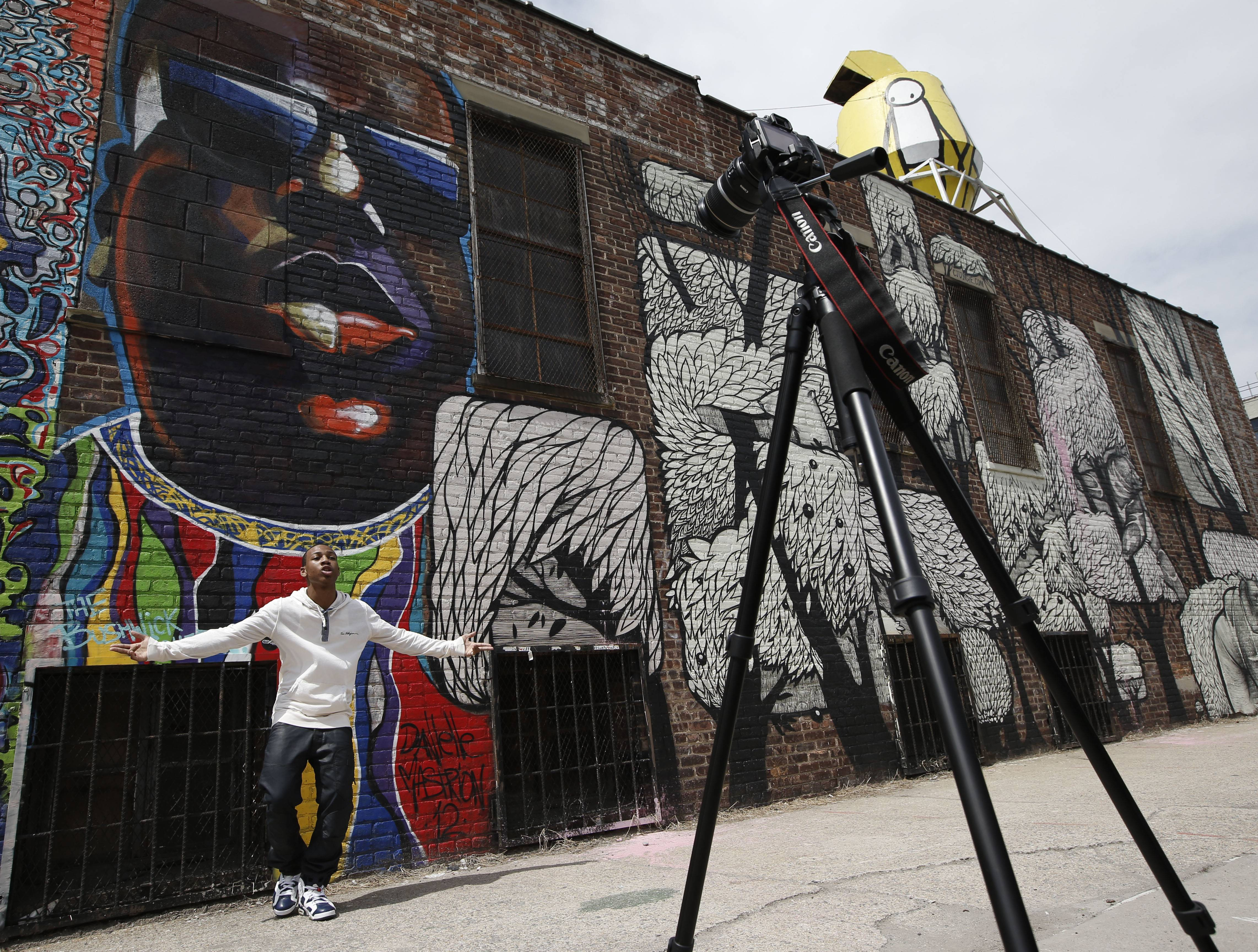 Jermaine McGriff, 20, a Bedford Stuyvesant-based rapper whose rap name is Flispy Flexin, records a music video in front of a street art portrait of the late rapper Biggie Smalls, also known as Notorious B.I.G., in Brooklyn's Bushwick neighborhood.