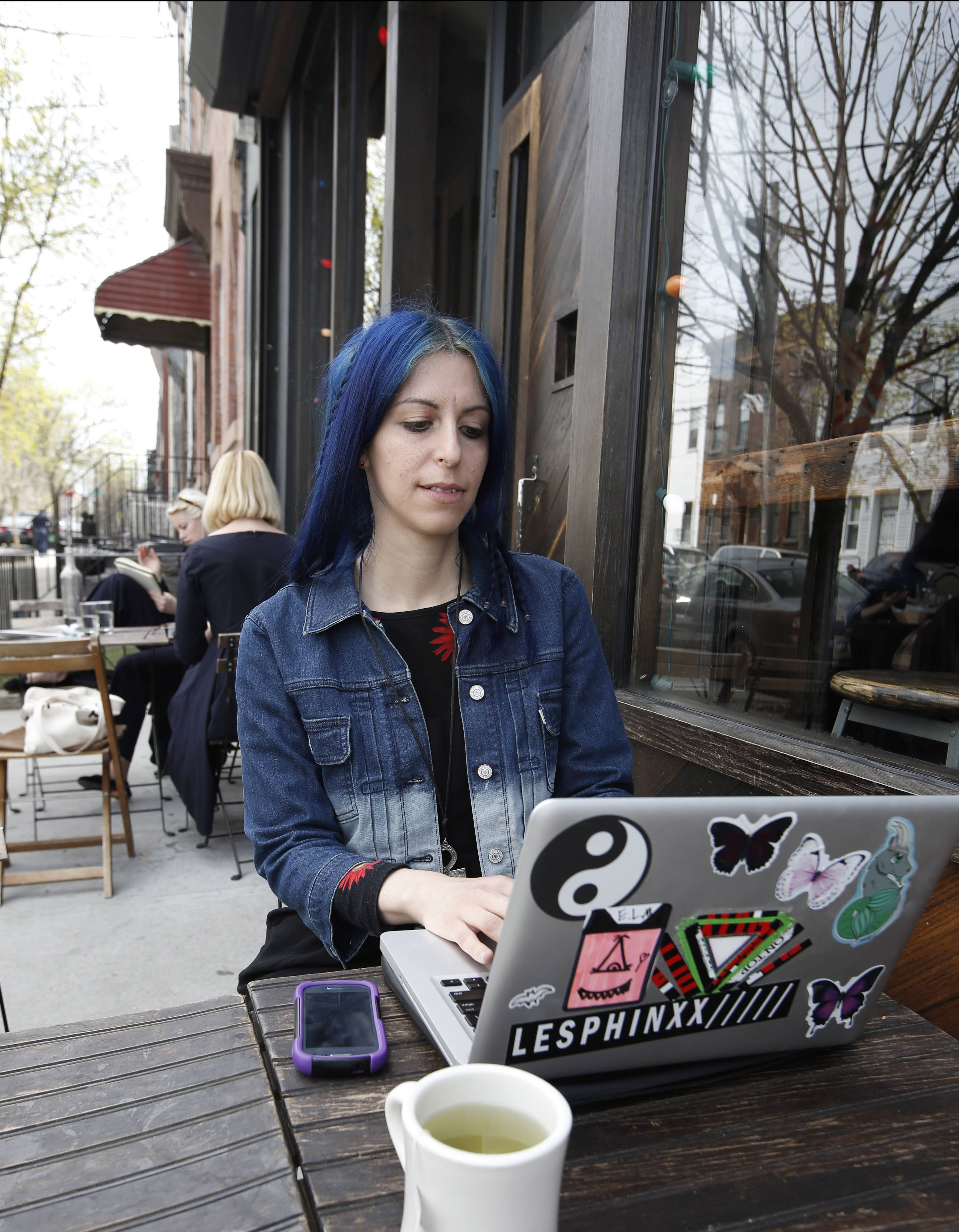 Doorways, a goth music performer and producer, works on her laptop at a cafe on a spring day in Brooklyn's cutting-edge Bushwick neighborhood. The area draws creative young people from all over the world.