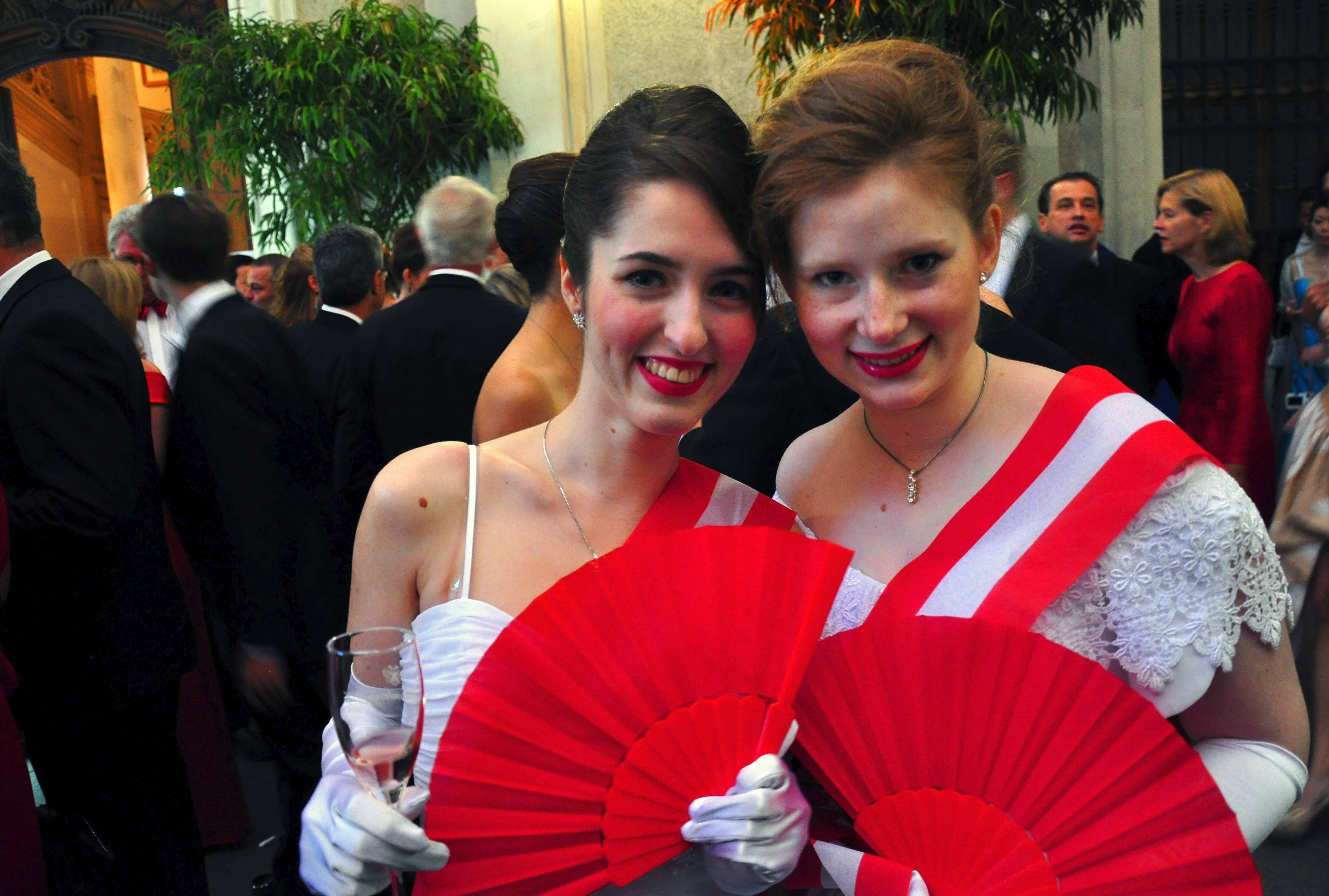 Debutantes are in high spirits during a cocktail reception prior to the opening of the Fete Imperiale ball in Vienna, Austria.