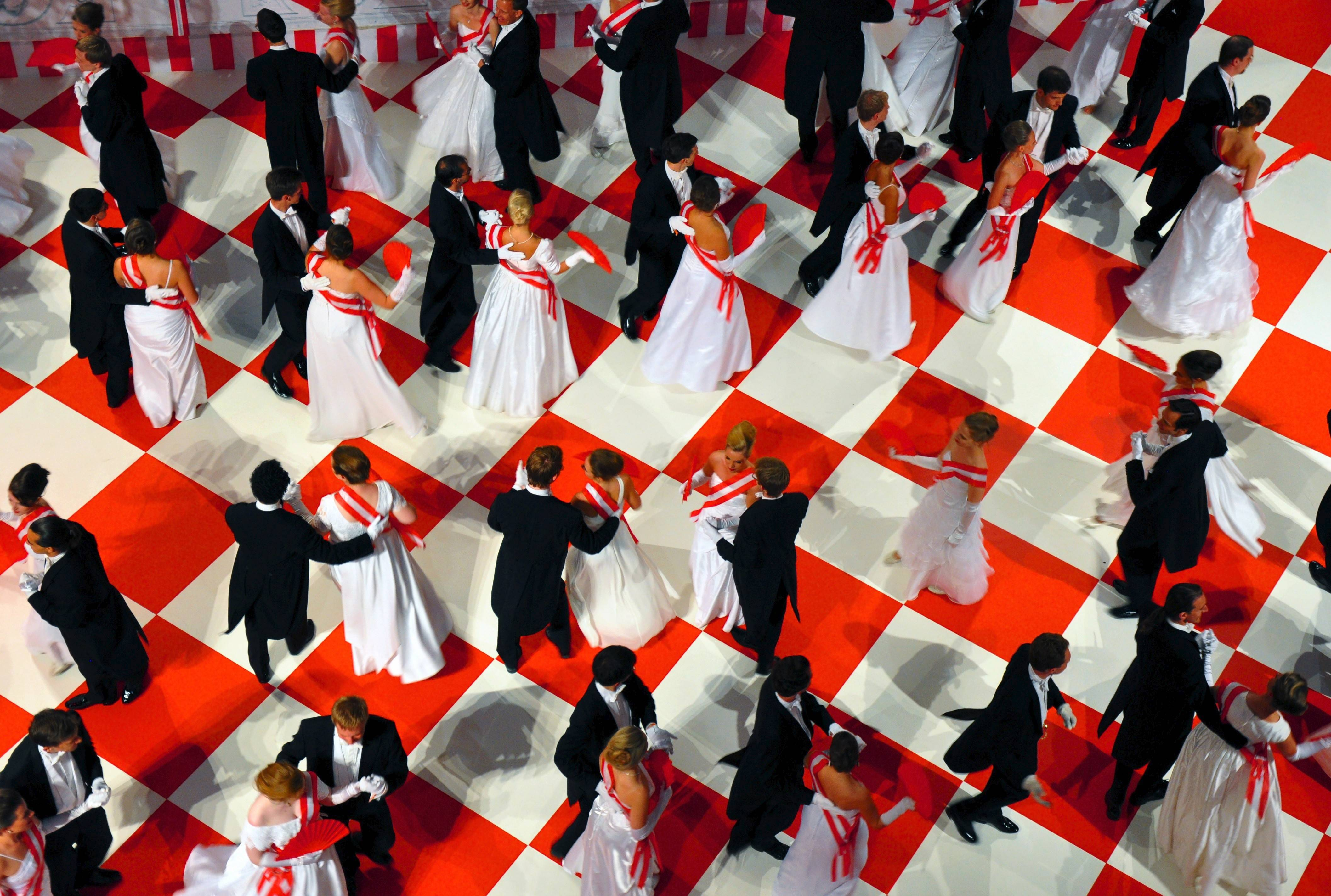 Debutantes and their escorts twirl in a waltz around the dance floor inside the Spanish Riding School during the Fete Imperiale ball in Vienna, Austria.