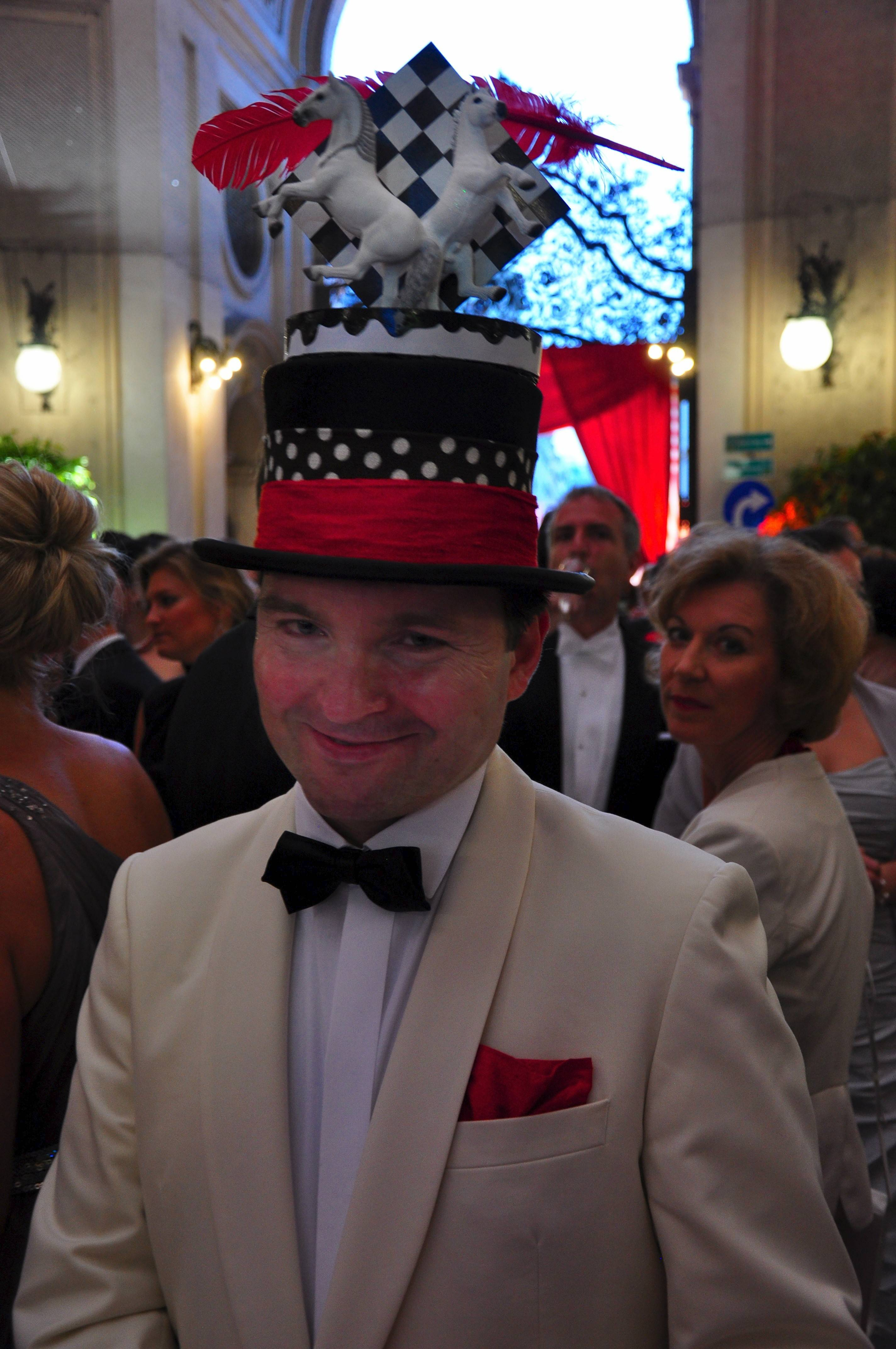 A young man gets into the spirit of Fete Imperiale with a festive hat. The ball, which benefits the Lipizzan horses, is one of the few summer balls held in Vienna, Austria.