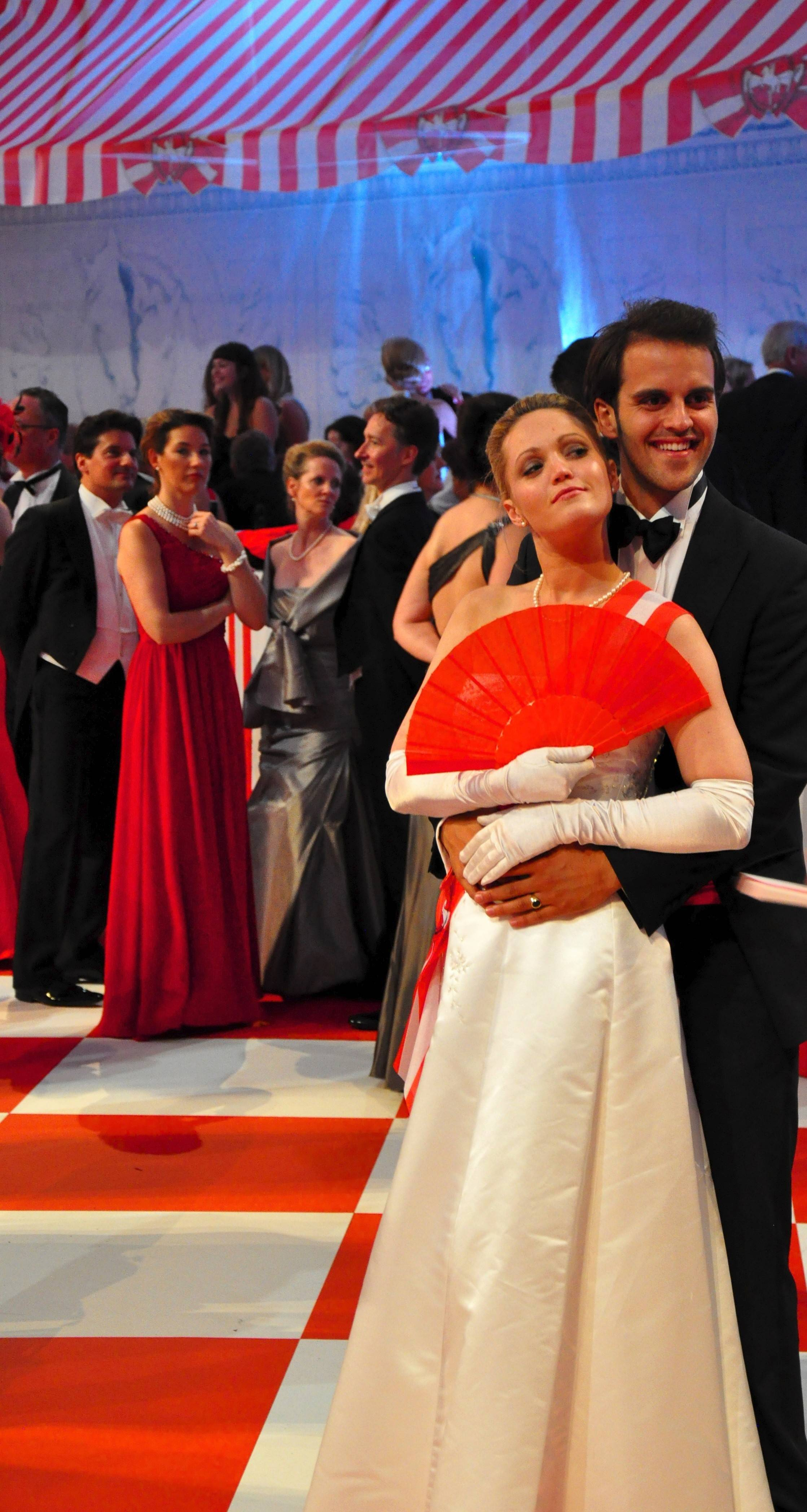Couples take a break from dancing during a long night of entertainment at the Fete Imperiale ball in Vienna, Austria.