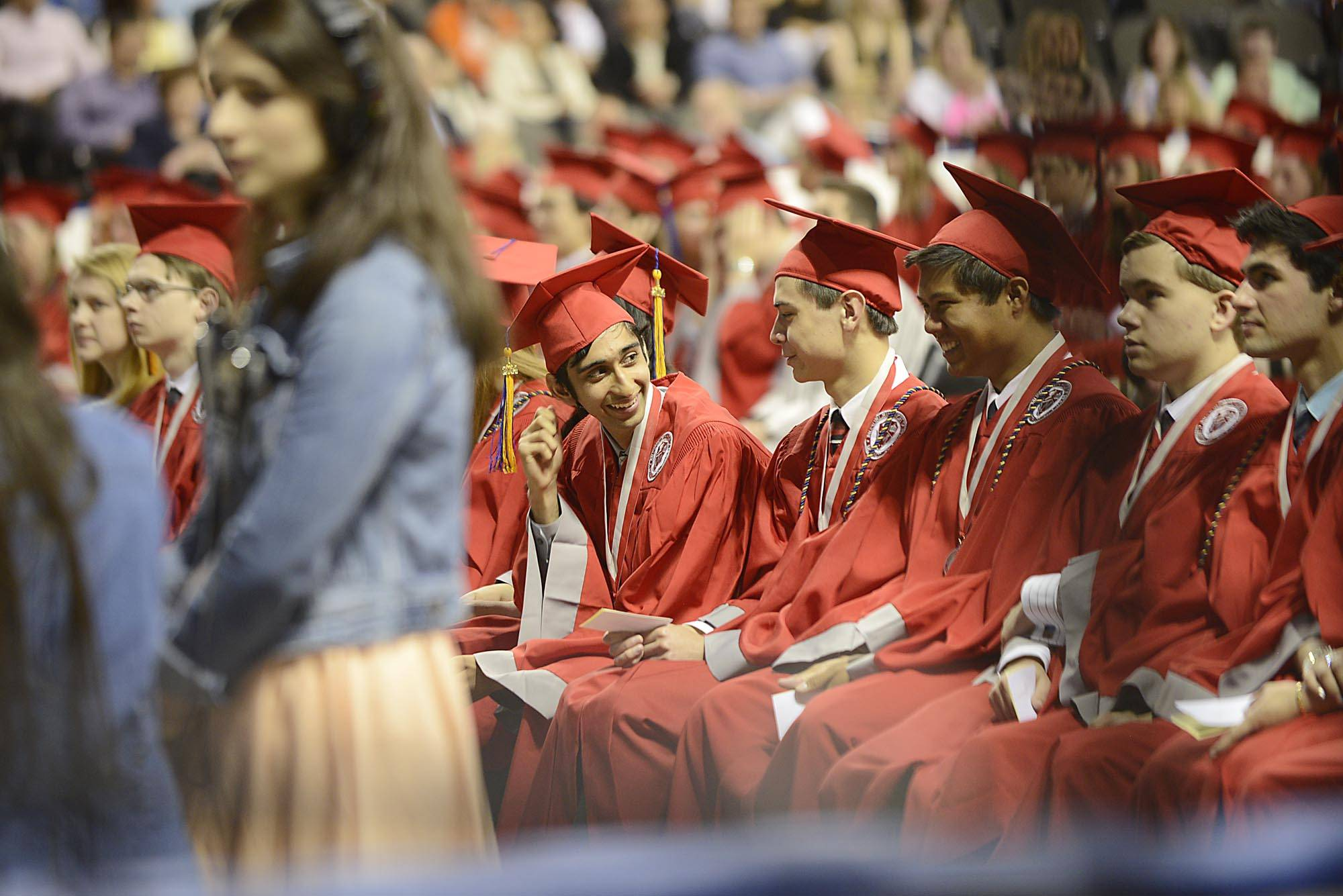 Valedictorian Aakash Choubal turns to his classmates after his address to the class Sunday at the Mundelein High school Commencement Exercises at Sears Center in Hoffman Estates.