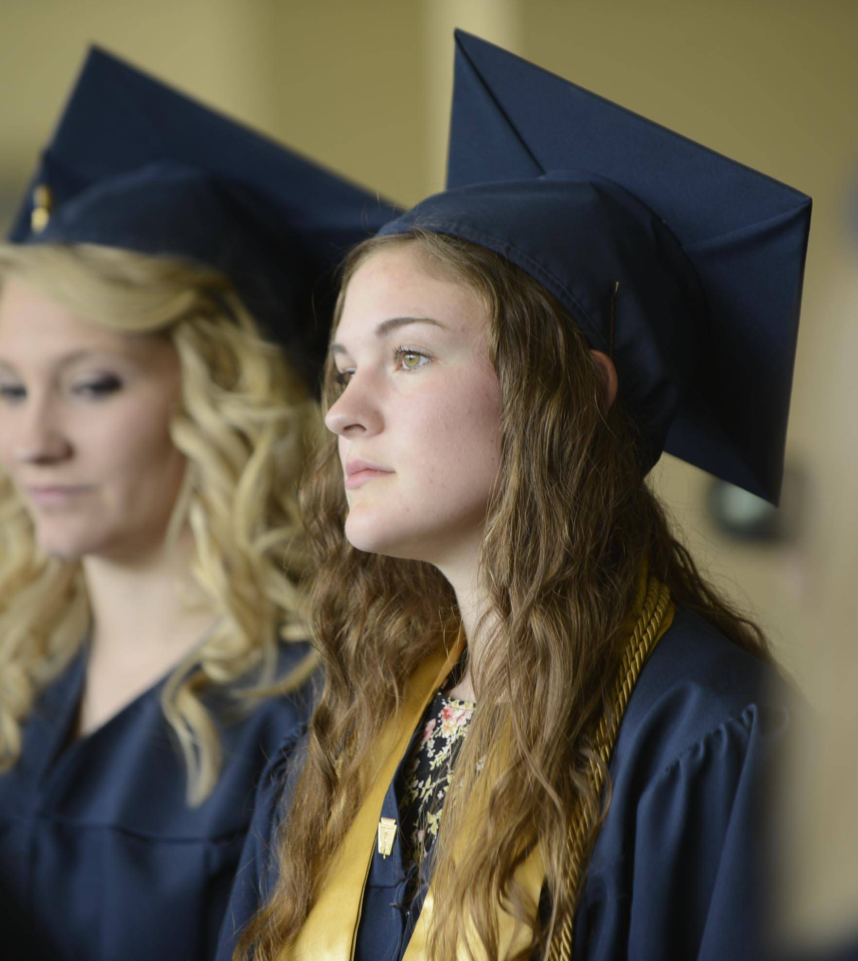 Valedictorian Anneliese Herman calmly waits Sunday at Harvest Christian Academy for graduation to begin in Elgin.