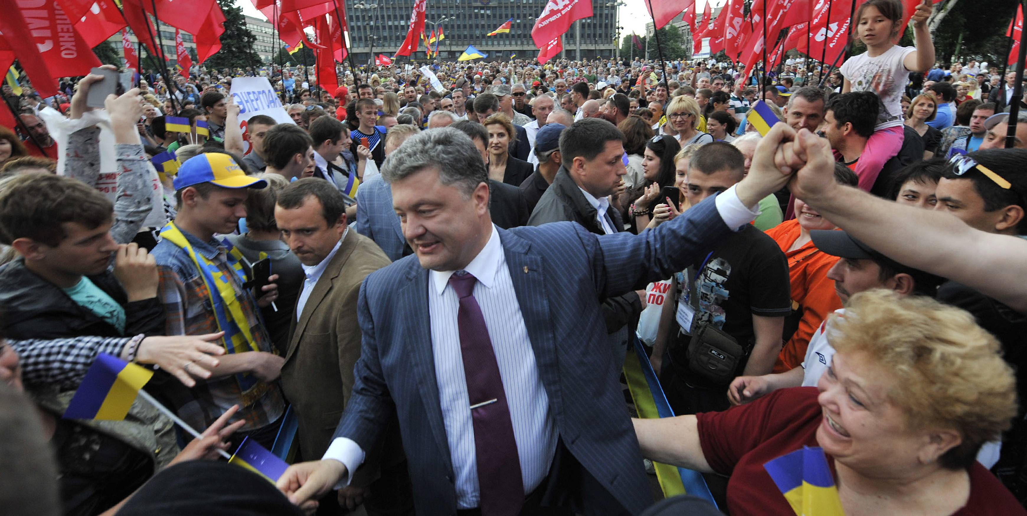 Ukrainian presidential candidate Petro Poroshenko, center, is welcomed by his supporters during a rally in Zaporizhzhia, Ukraine, Sunday. The presidential vote in Ukraine is scheduled for May 25.