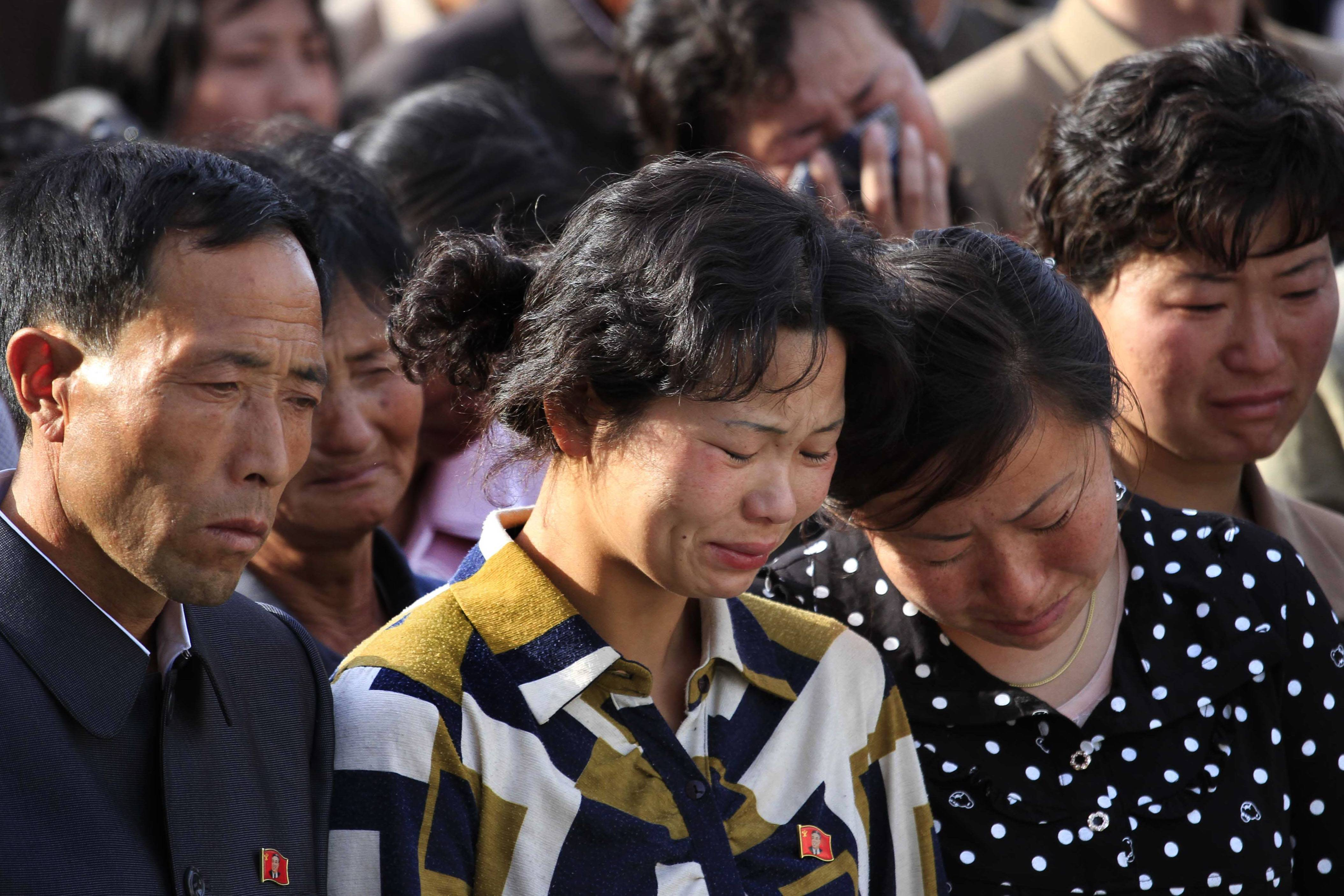 Families of victims of an accident at an apartment construction site in Pyongyang, North Korea, grieve Saturday during a gathering in the capital where senior officials apologized and took responsibility.