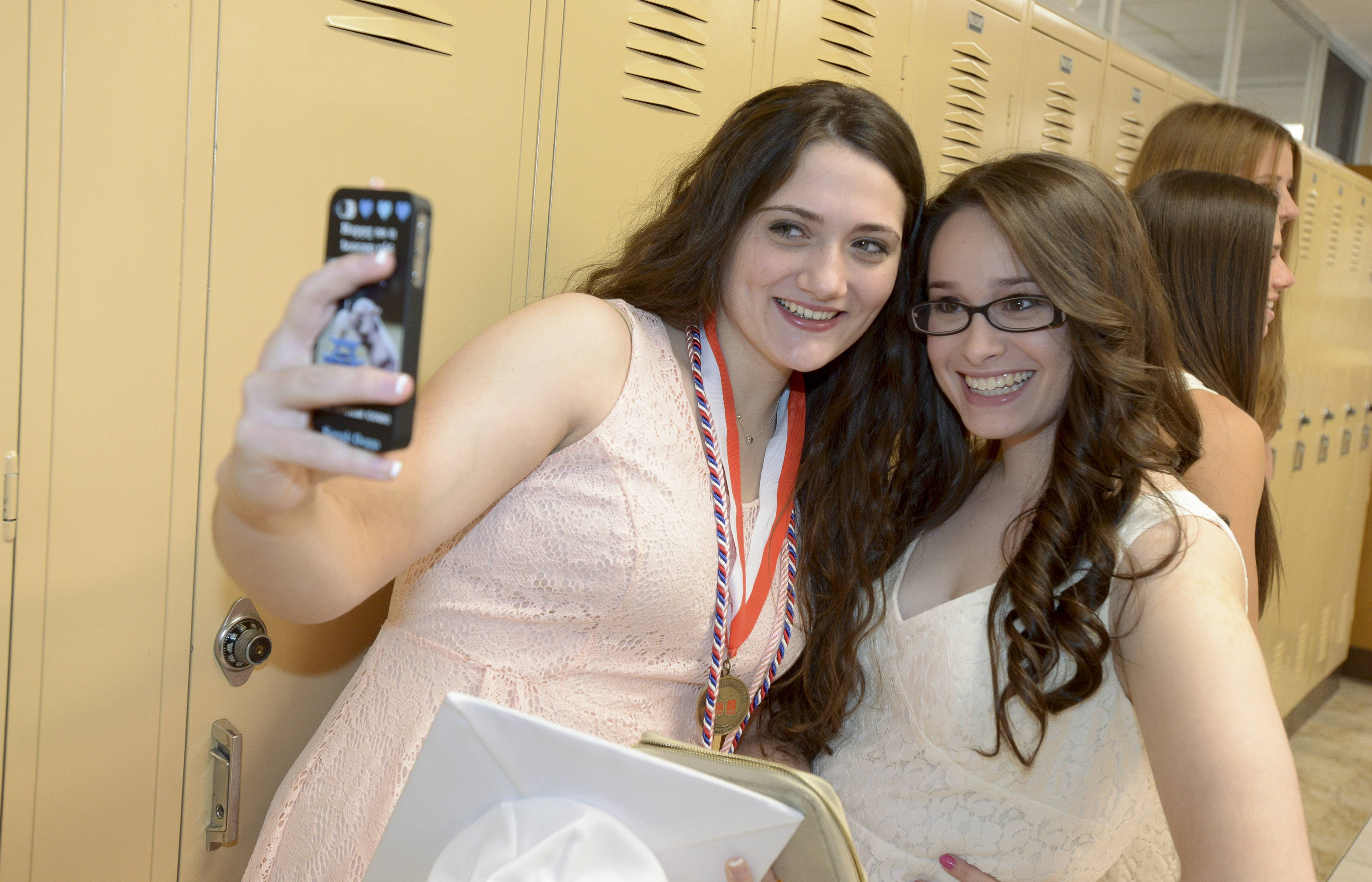 Sarah Dopp and Sabrina Bates take a selfie before Montini Catholic High School's graduation on Sunday, May 18 at Montini in Lombard.