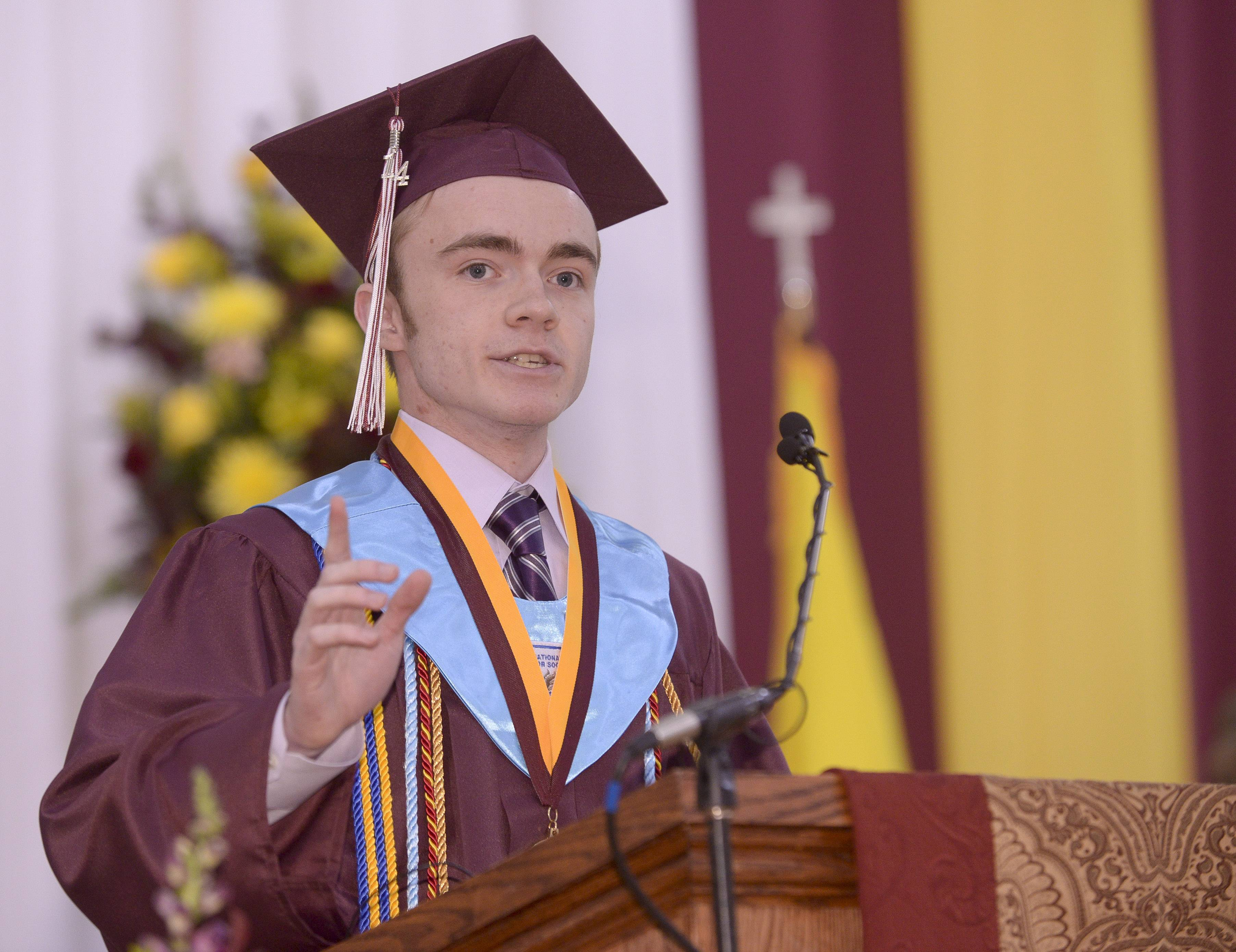 Valedictorian Gabriel Lynch speaks during the Montini Catholic High School graduation Sunday, May 18, at Montini in Lombard.