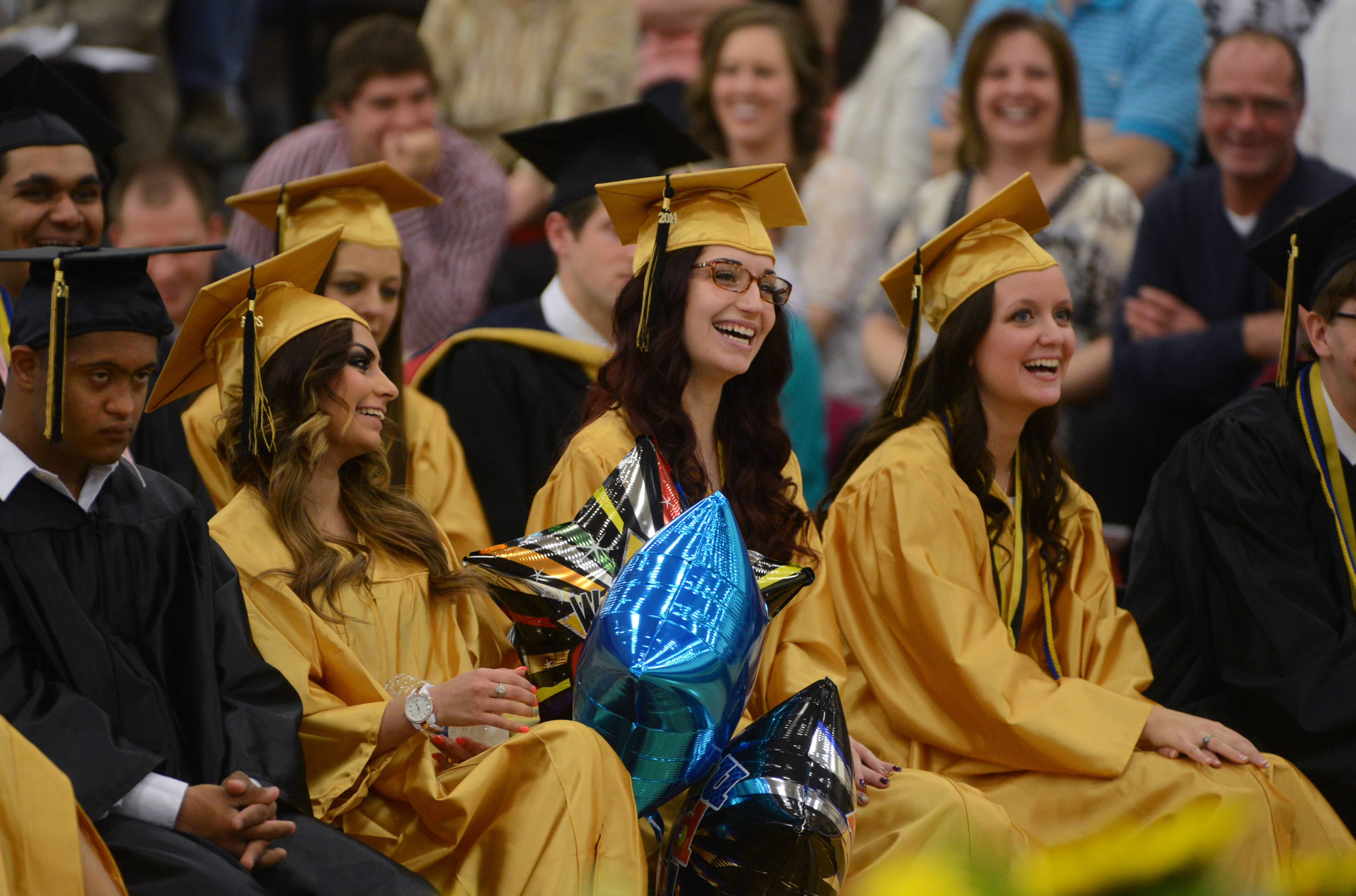 Grayslake North graduates and guests enjoy Sunday's staff speaker Brent Sadewater during the commencement ceremony.