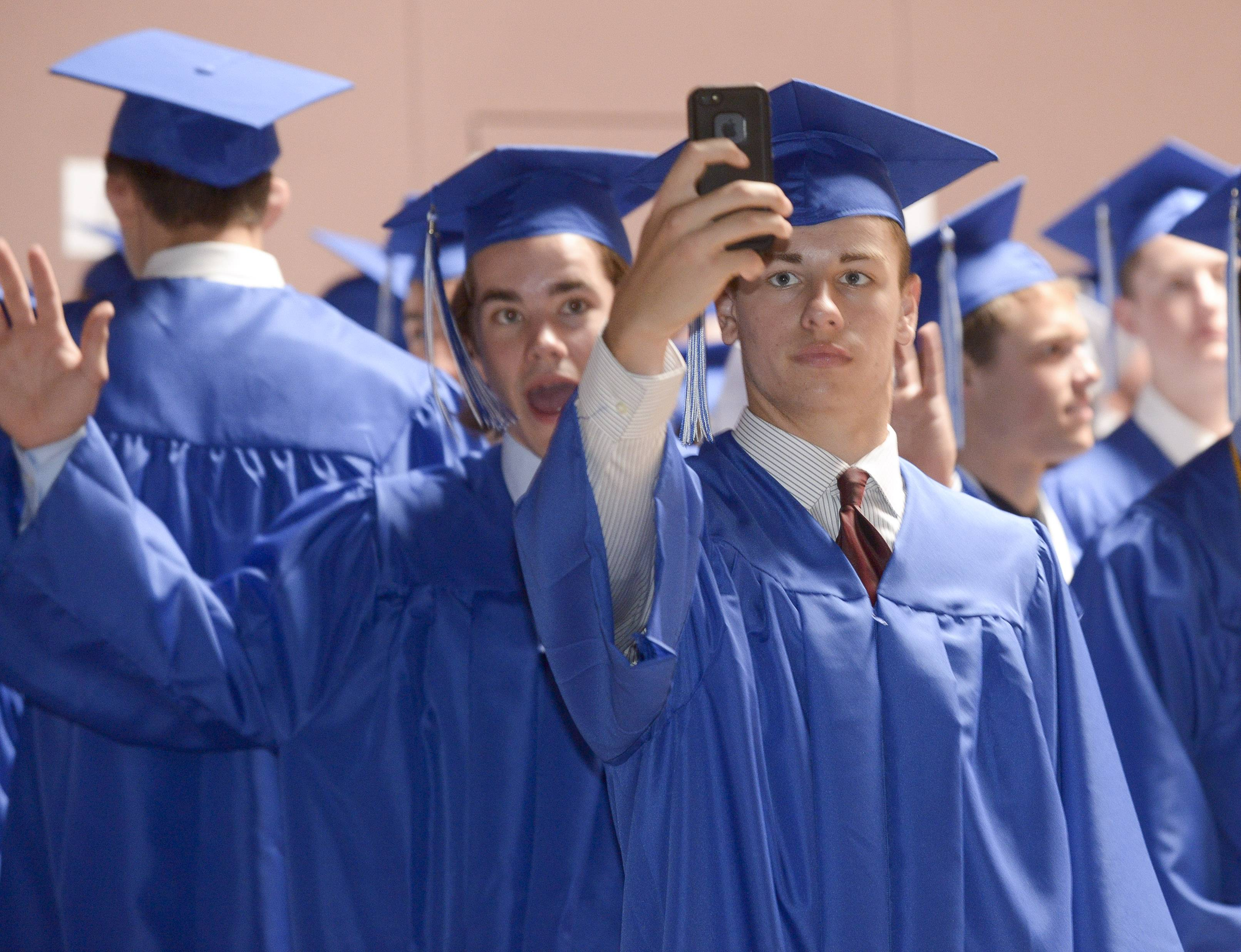 Matt Kelly of Wheaton takes a selfie before the start of the St. Francis High School graduation Sunday, May 18 at St. John Neumann Church in St. Charles