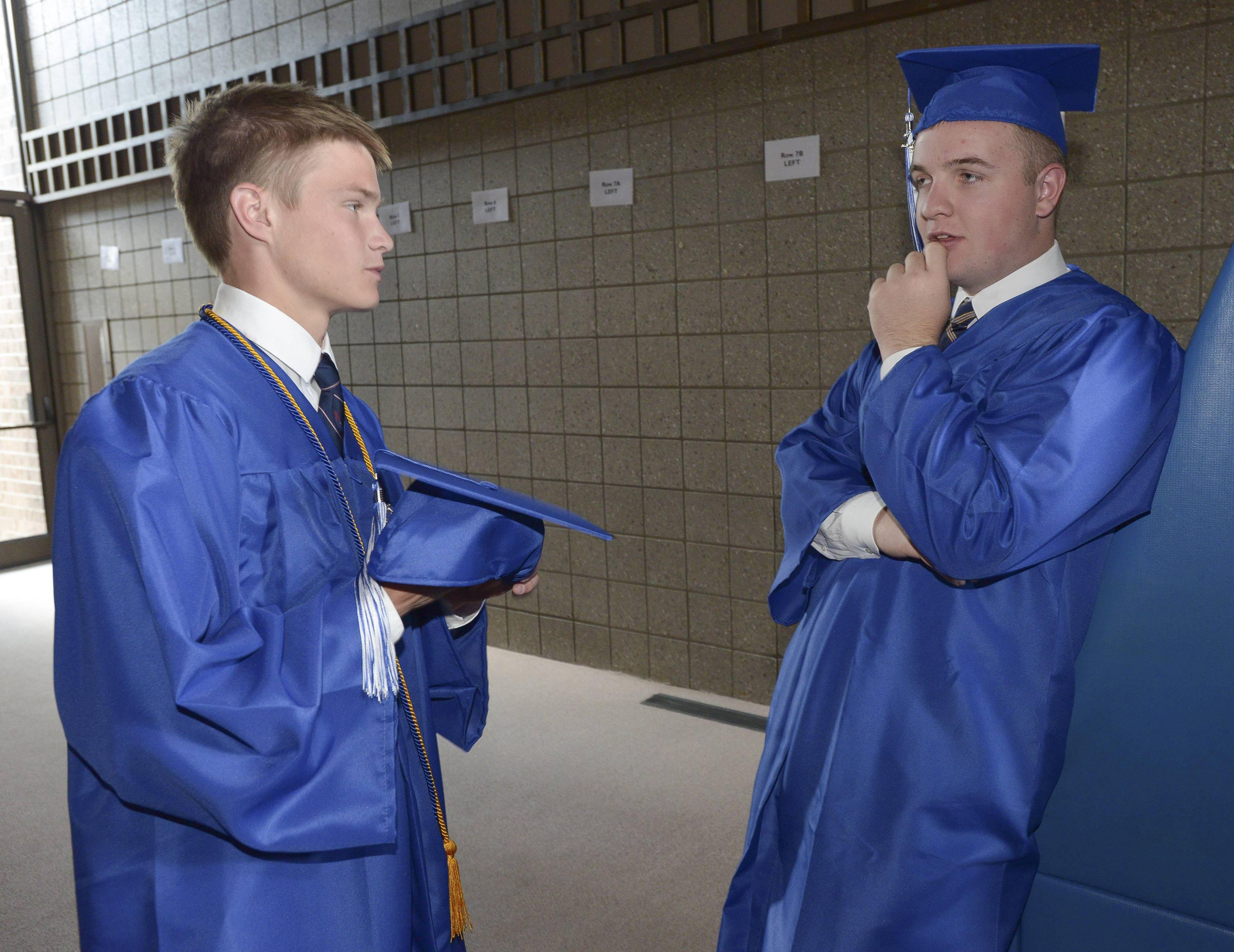 Matt Armbrust and Andrew Oleniczak hang out before the start of the St. Francis High School graduation Sunday, May 18 at St. John Neumann Church in St. Charles