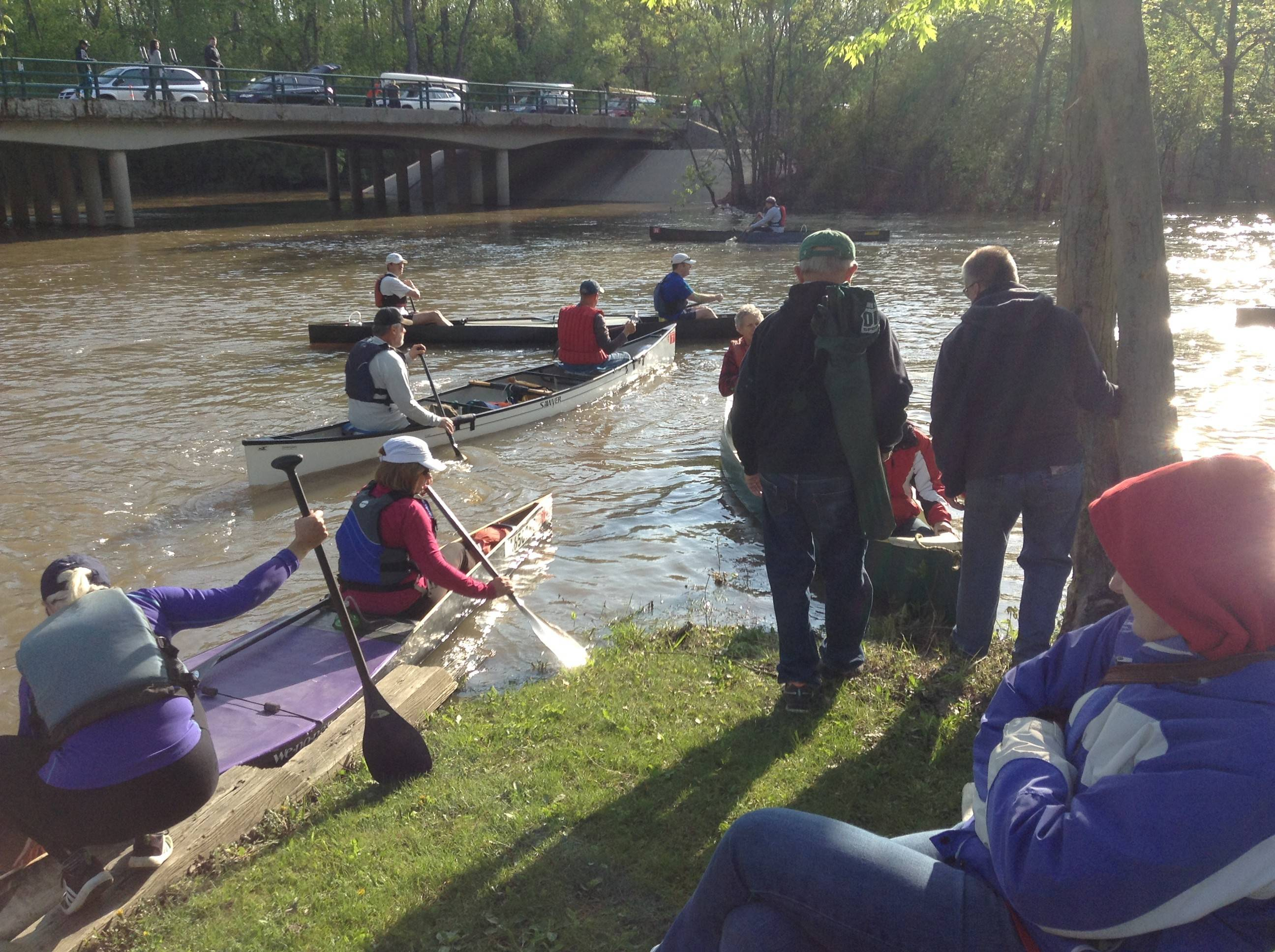 Racers paddle toward the starting line at the Des Plaines River Canoe and Kayak Marathon in Libertyville on Sunday. Organizers nearly canceled Sunday's race because of high water and the swift current of the river, but decided to allow it to go on as scheduled after warning participants of the conditions.